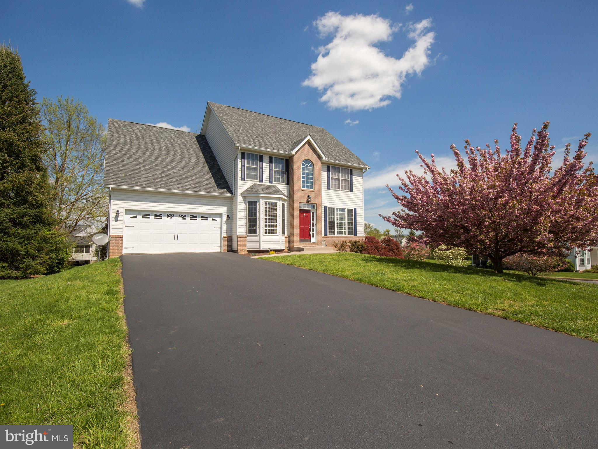 Relax on your spacious deck and watch the golf carts go by!  Spacious colonial on corner lot backing