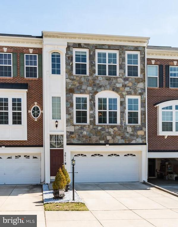 LIKE NEW! Contemporary 3 Level Townhome. Front Entry, 2 Car Garage and Stone Exterior. Private Fence