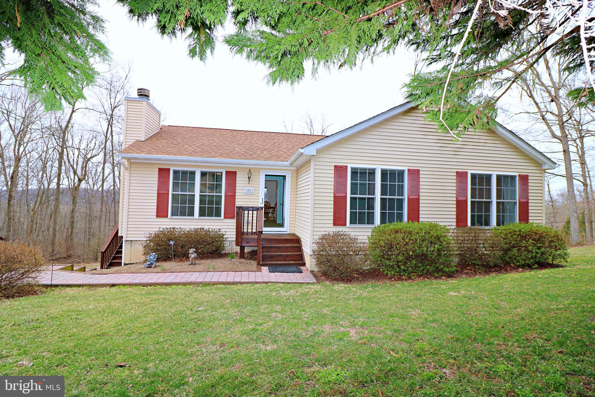 Conveniently nestled inside Gate 1 of the Shannondale Community in Jefferson County WV sits this 3-b