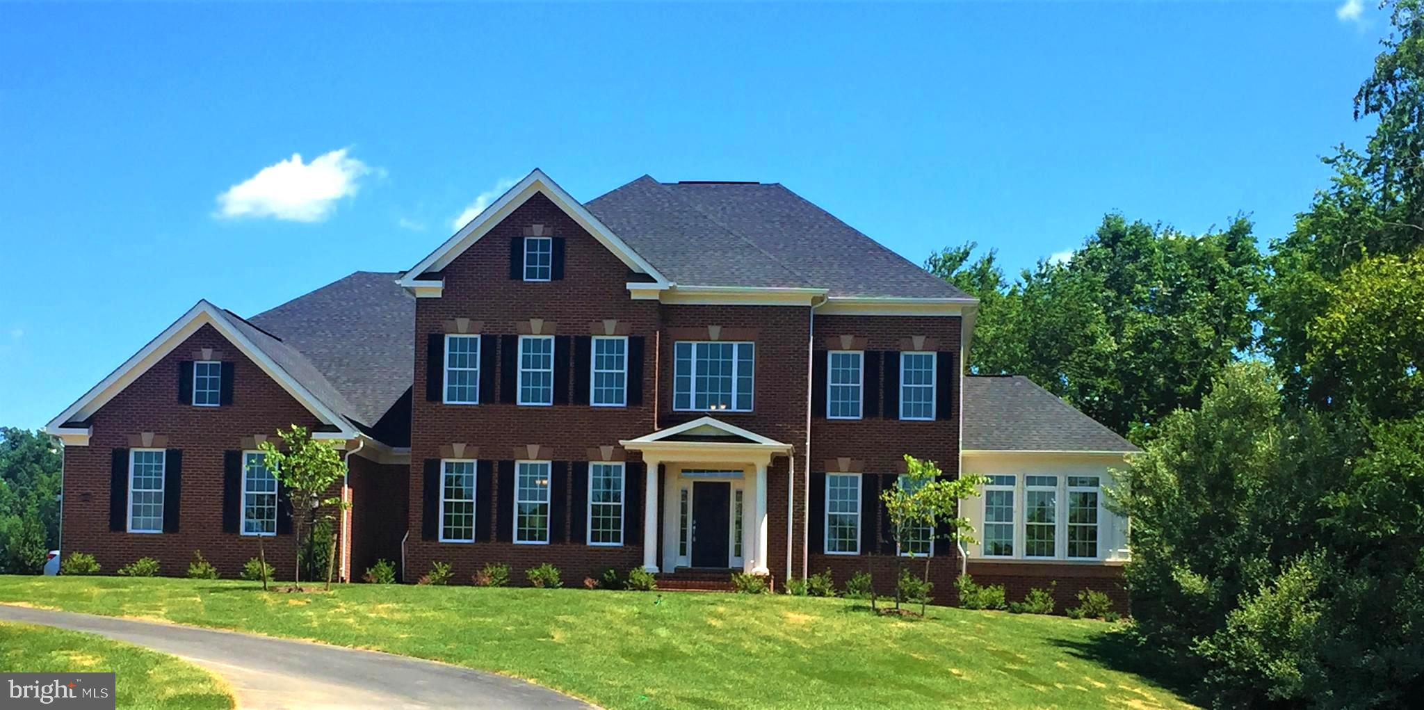 UNDER CONSTRUCTION by CarrHomes on gorgeous wooded 3 acre homesite. This Oakton plan has over 6200 s