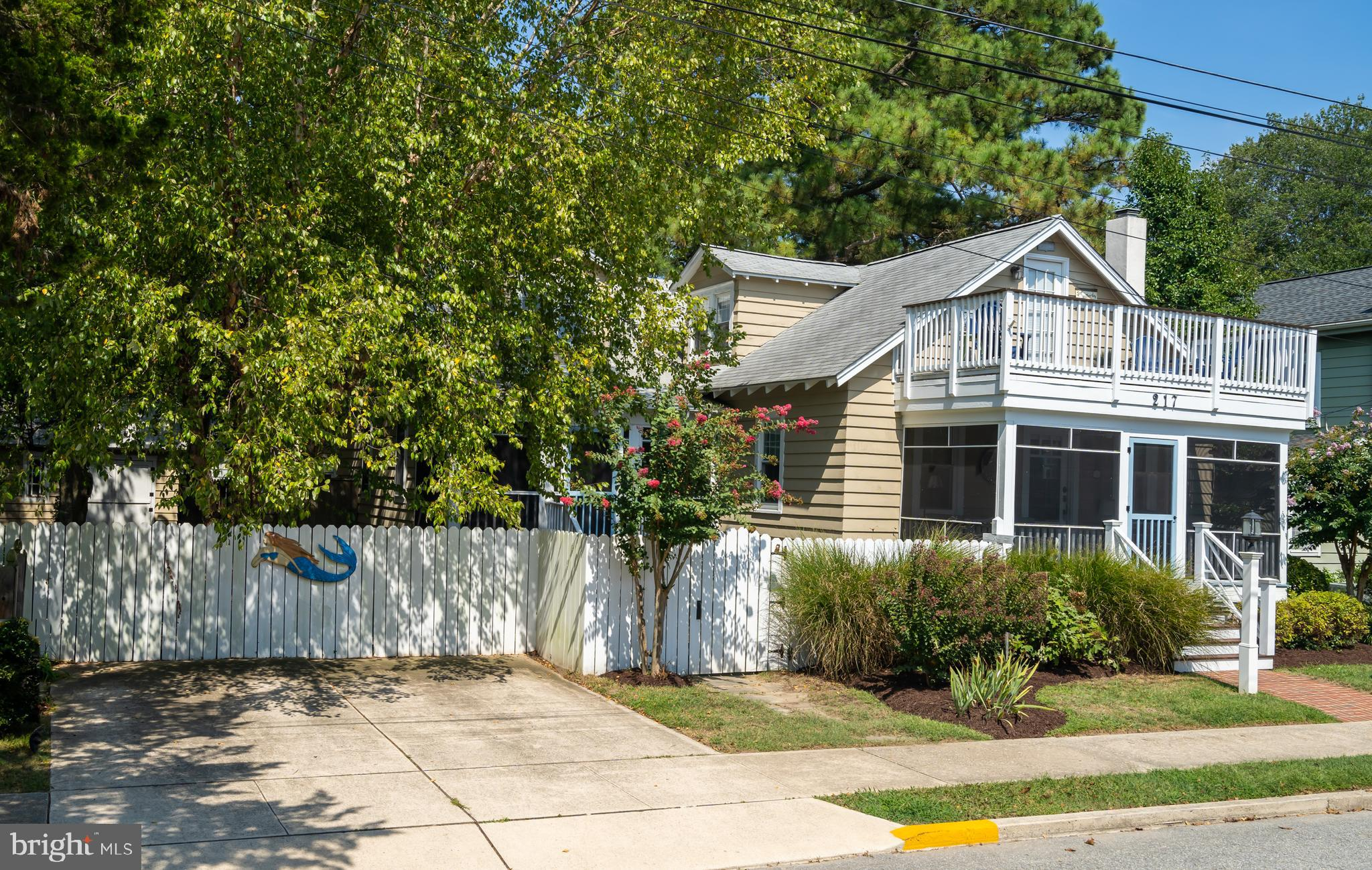 2.5 blocks to the beach! Recently renovated Rehoboth classic coastal cottage with 6 bedrooms and 5 f