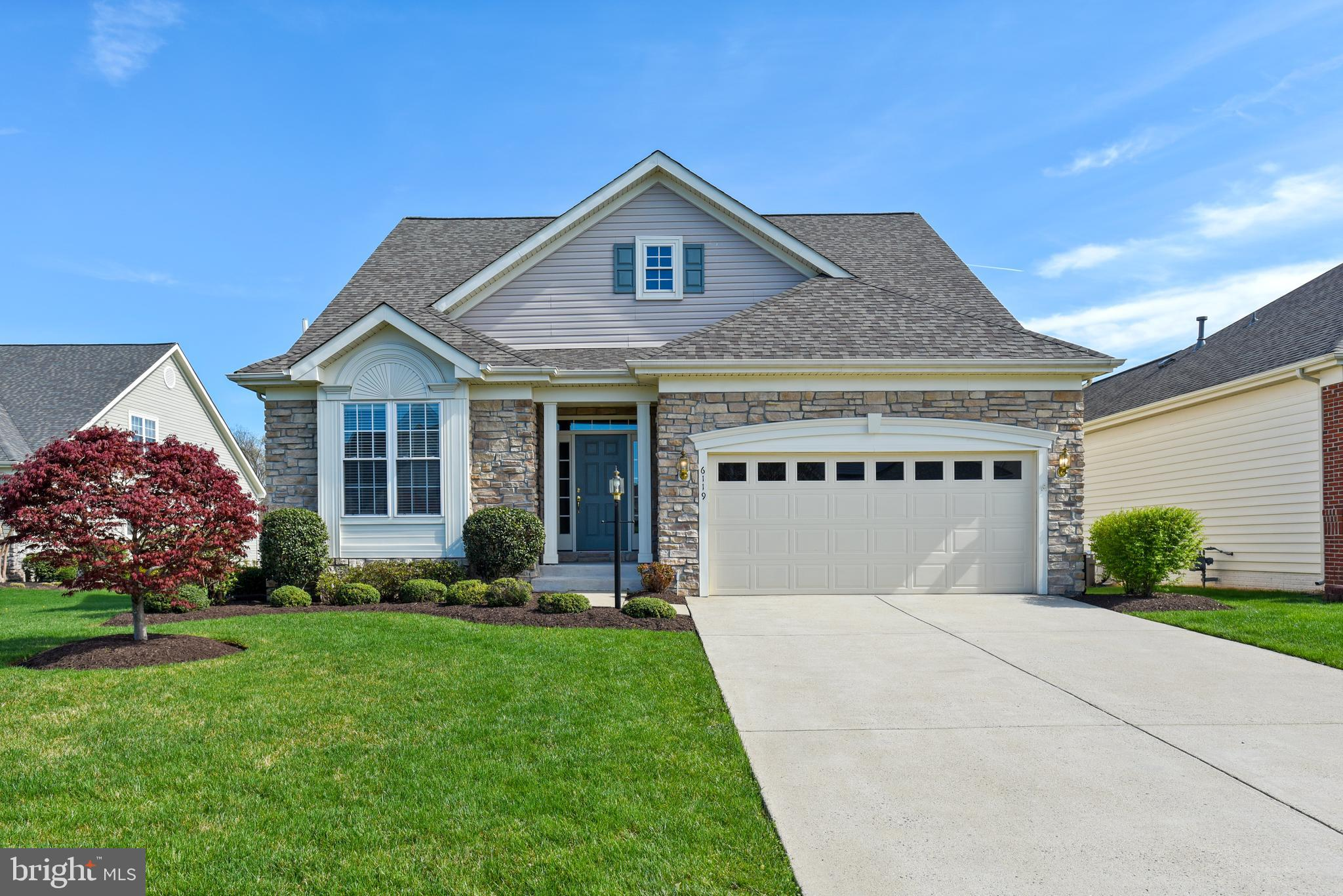 Welcome Home to this gorgeous home with a pond view in the 55 and better community of Heritage Hunt!