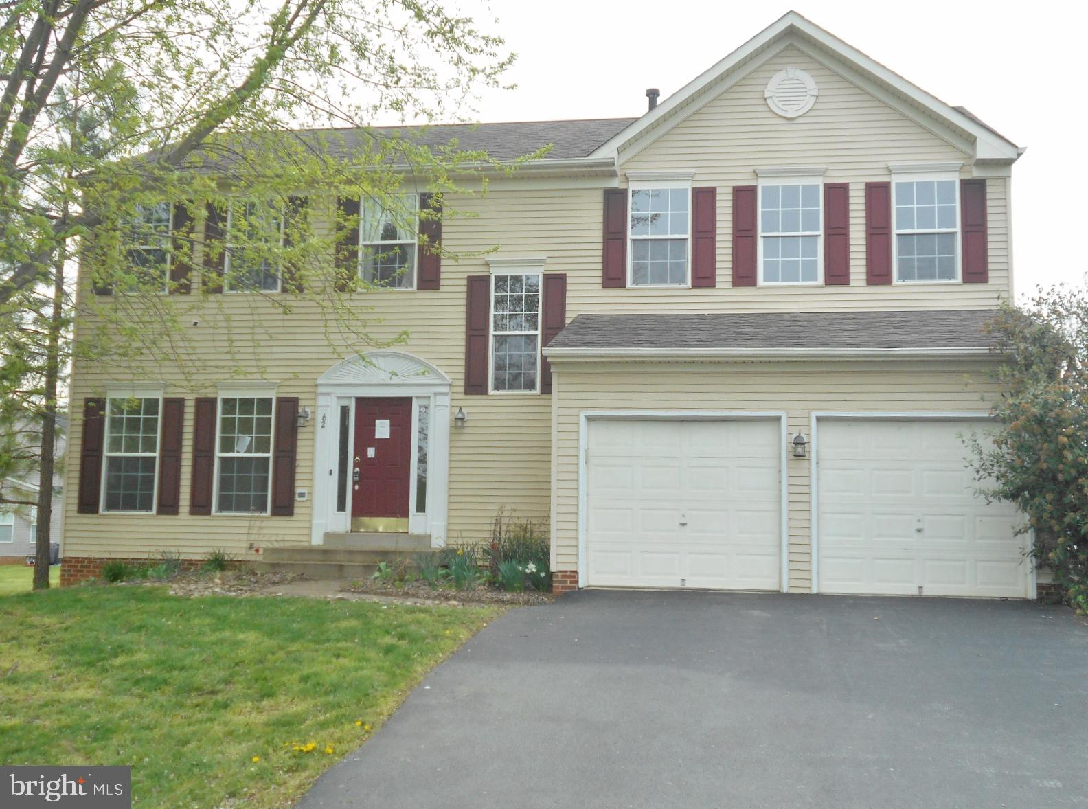Spacious Colonial home in Locust Hill Golf Course community.  Main level includes formal living and