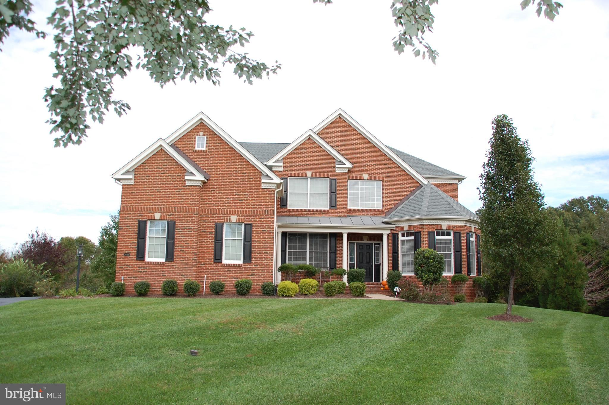 Prestigious Gated Golf Course Community of Dominion Valley!  Brick front with 3 car side load garage