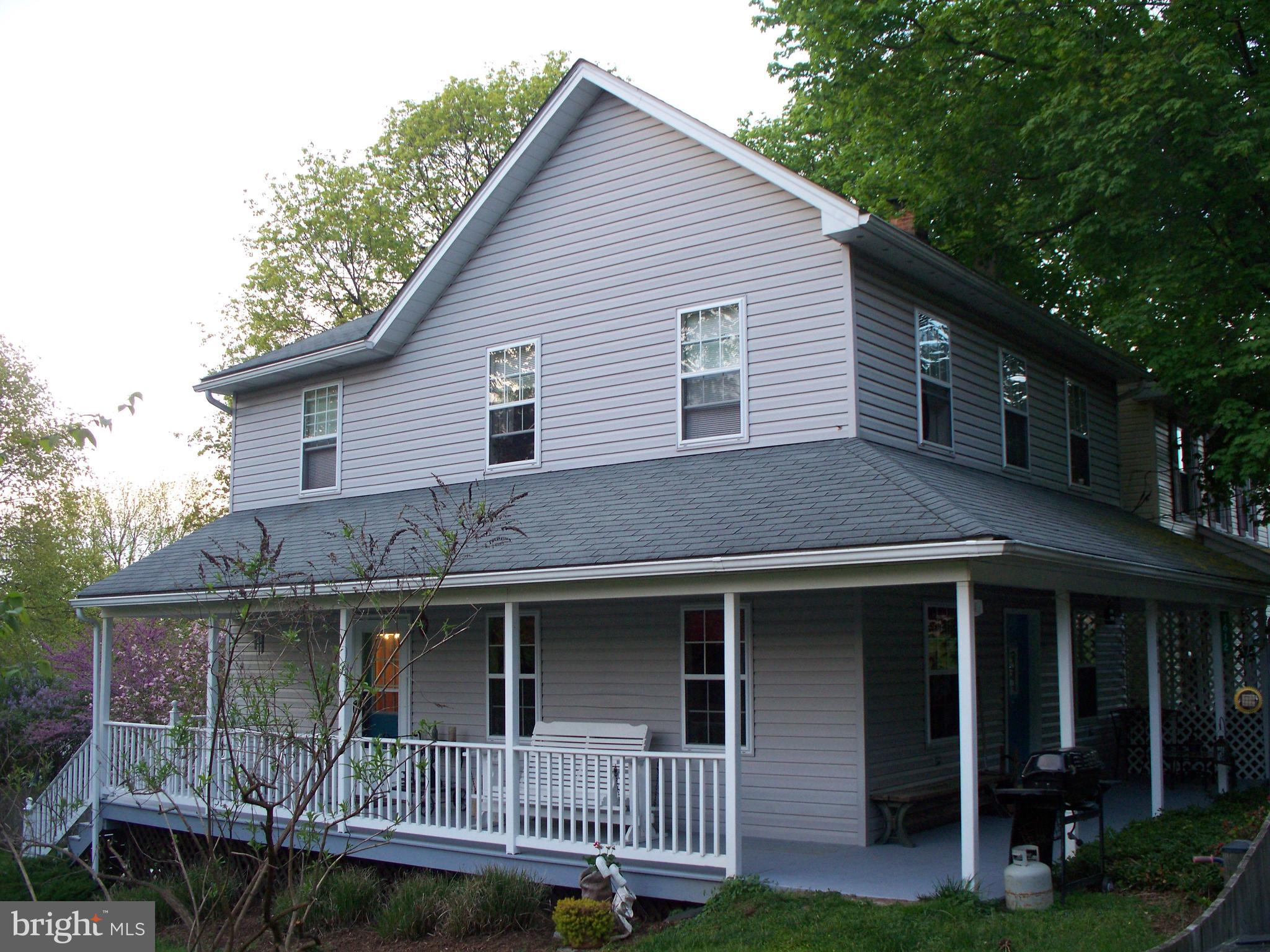 Charming colonial with large wrap-a-round porch on a quiet residential street.  Fully fenced yard *