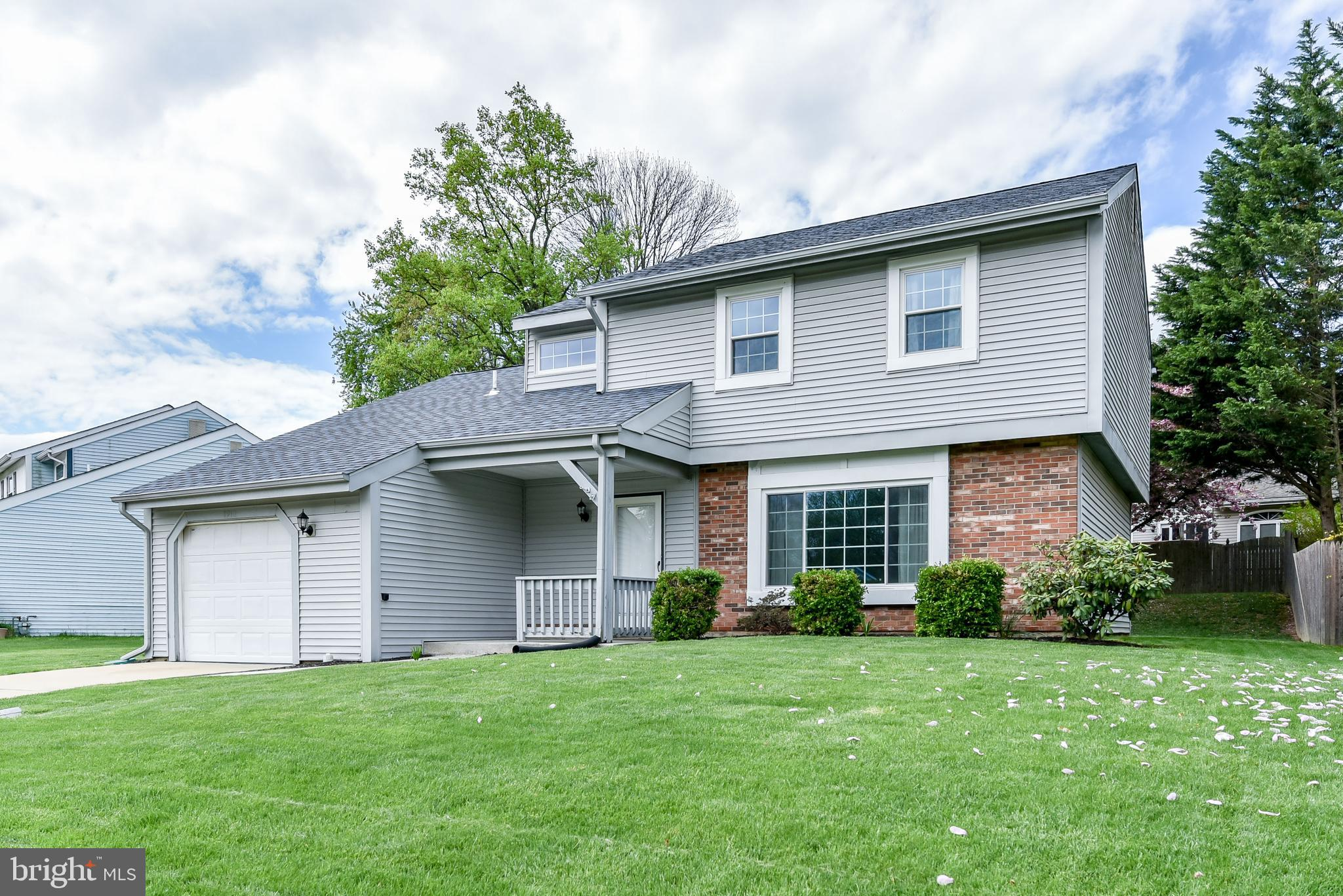 Nestled in the esteemed Woodmill Village and perched on a perfect parcel, is 1910 S. Woodmill Drive,