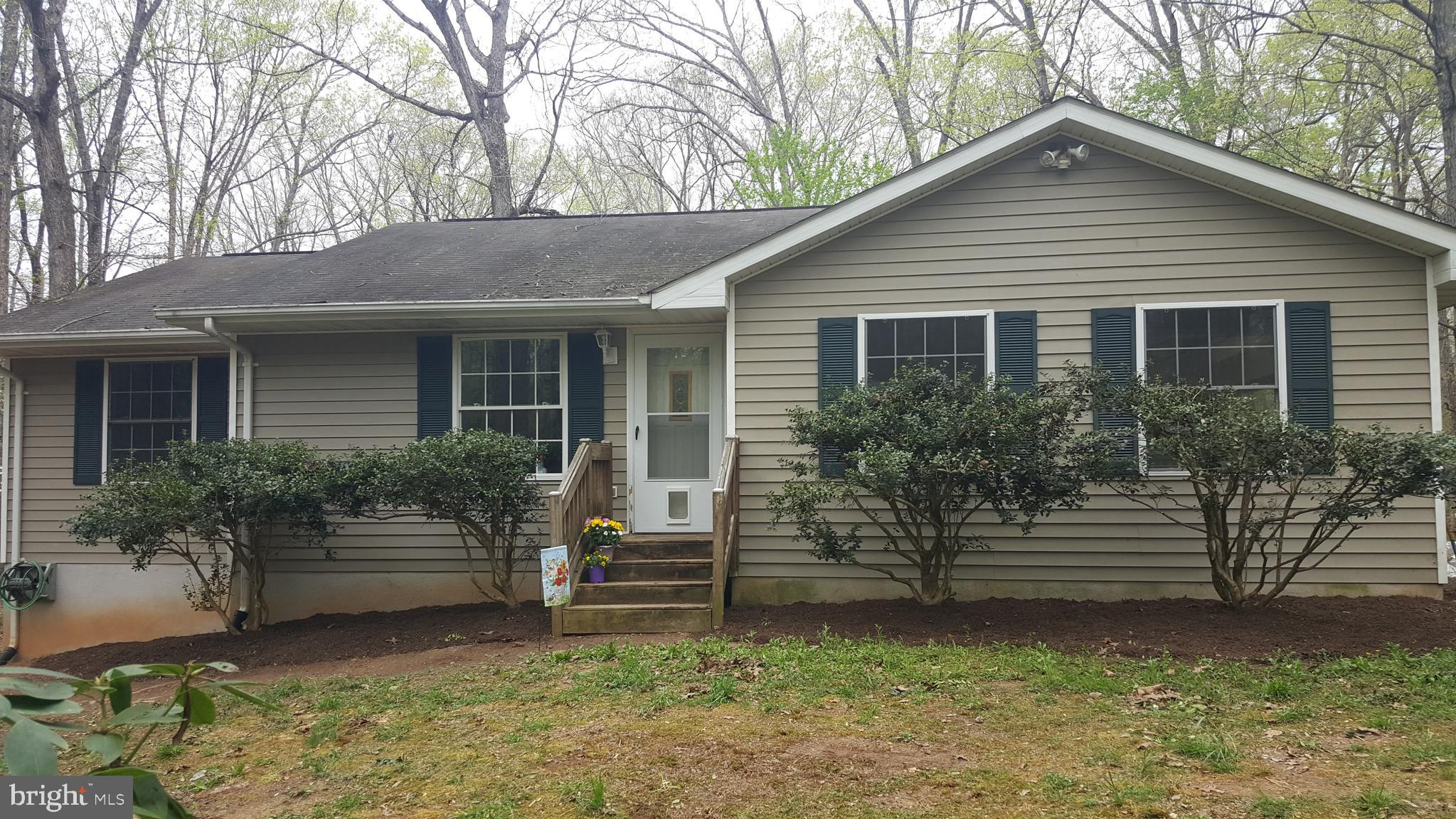"""BRING OFFERS! """"AS-IS"""" Rambler on 2.45 wooded acres priced to sell fast! Owner not doing any repairs to leave this 3 Bed 3 Bath Raised Rambler with 2040 total square ft up/down, 1530 finished total, 1020 upper and 510 down, 510 unfinished down. This is a great fixer upper with solid bones, DRY BASEMENT! for someone who wants to put in the sweat equity to re-finish kitchen, replace carpets (Pet Damage), repair some drywall and moldings and re-do a kitchen floor. Attached 2 car garage with newer opener, newer AC/heat pump units and electronic humidifier with about 10 months of Appleton Campbell pre-paid service agreement on it. Newer water heater and water treatment system. Washer and dryer do not convey. NO HOA, just a minor road agreement. The kitchen needs work. Appliances are old. Sliding Double Glass Door to beautiful deck with mountain views. There are 3 beds upstairs and 2 full baths. Downstairs is 65% finished with a big living room, a full bath, a bonus room/Den/Office and walkout basement double French Door.  Home last sold for $291,000 on 9/25/2006. Pricing estimates and Bed/Bath information on Zillow and others is incorrect and incomplete. See old MLS listing VACU102308. Comcast cable installed, electric, well, septic all functioning. No fireplace."""