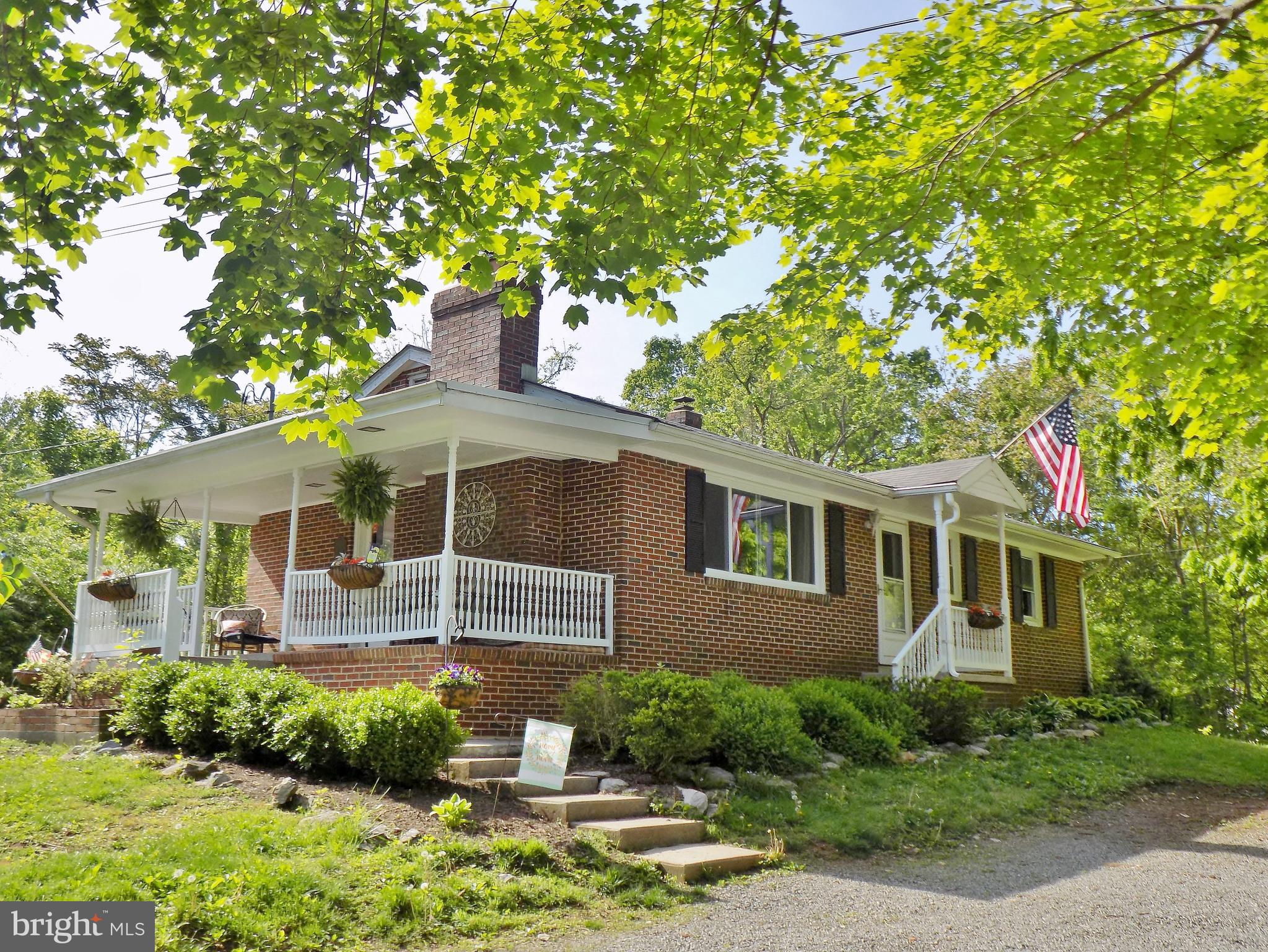 Move in ready solid brick home on 2 wooded and open rolling acres minutes from Route 7 for commuters