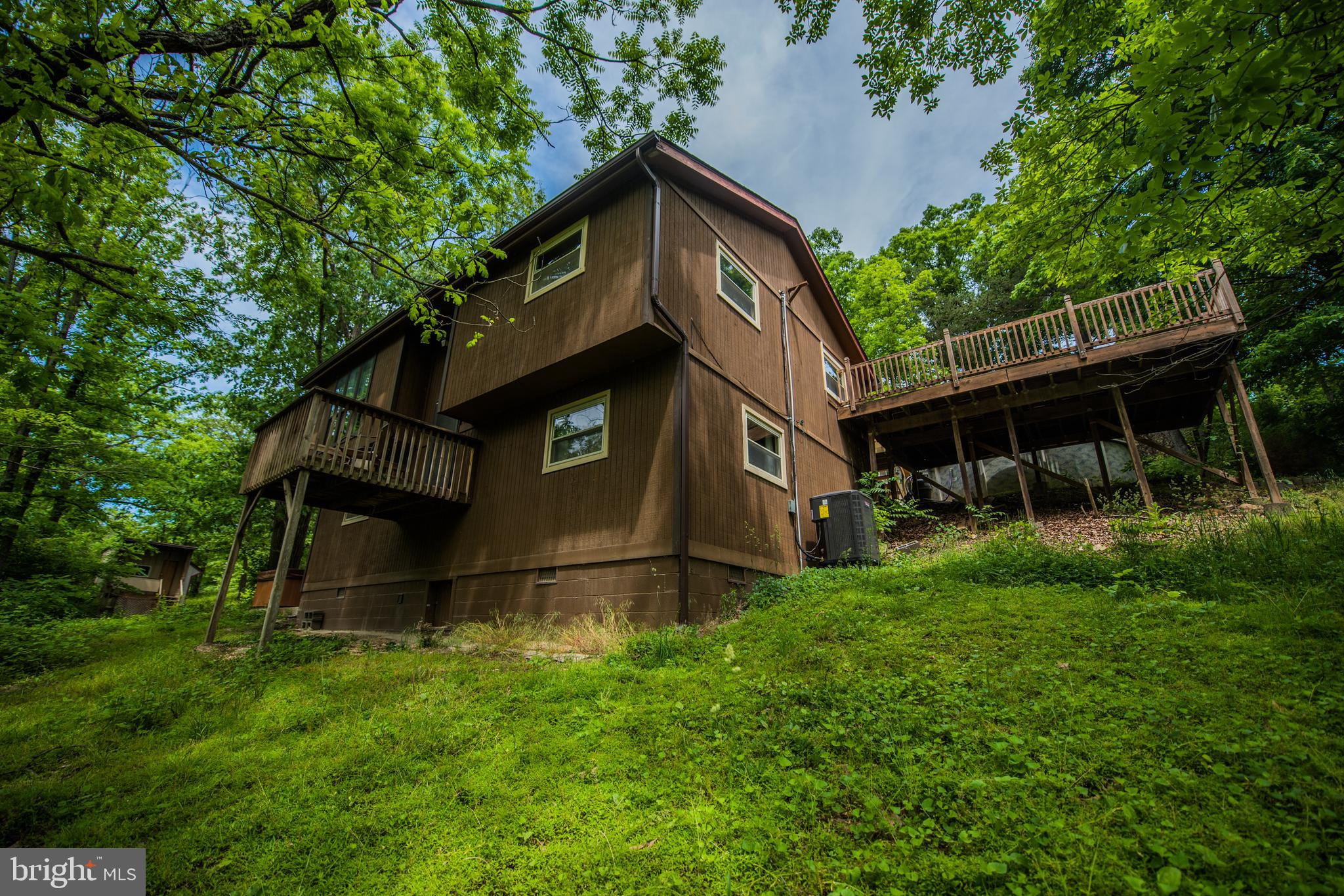 AMAZING park like setting, large deck connected to above ground pool. Overlooking year round creek.