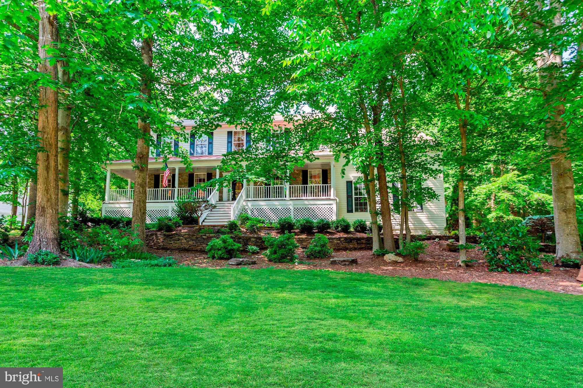 Absolutely gorgeous colonial with wrap-around front porch meticulously maintained by original owners
