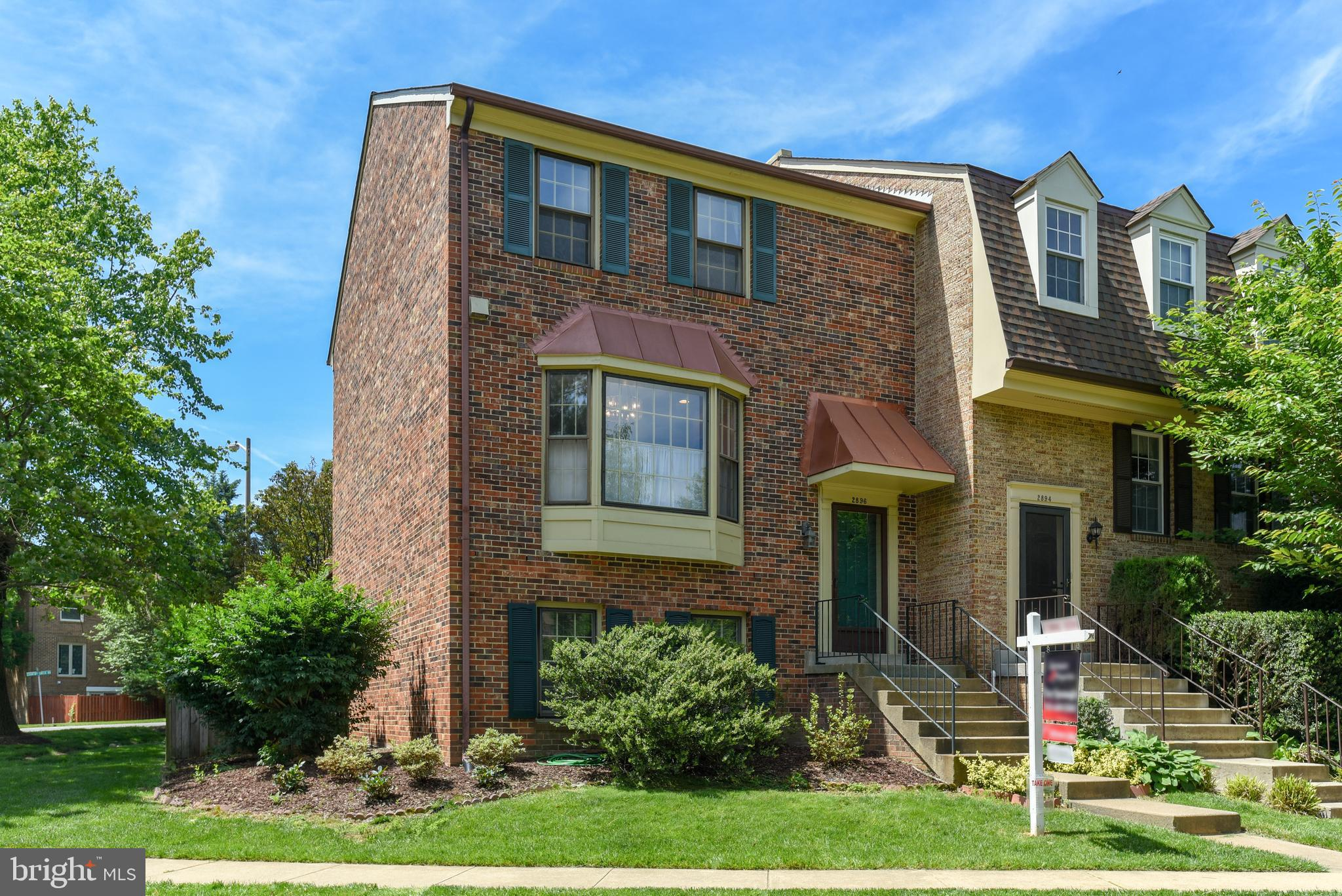 Upgraded, newly painted and MOVE-IN READY 4 Bedroom, 3.5 Bath all brick End Unit Townhome that makes