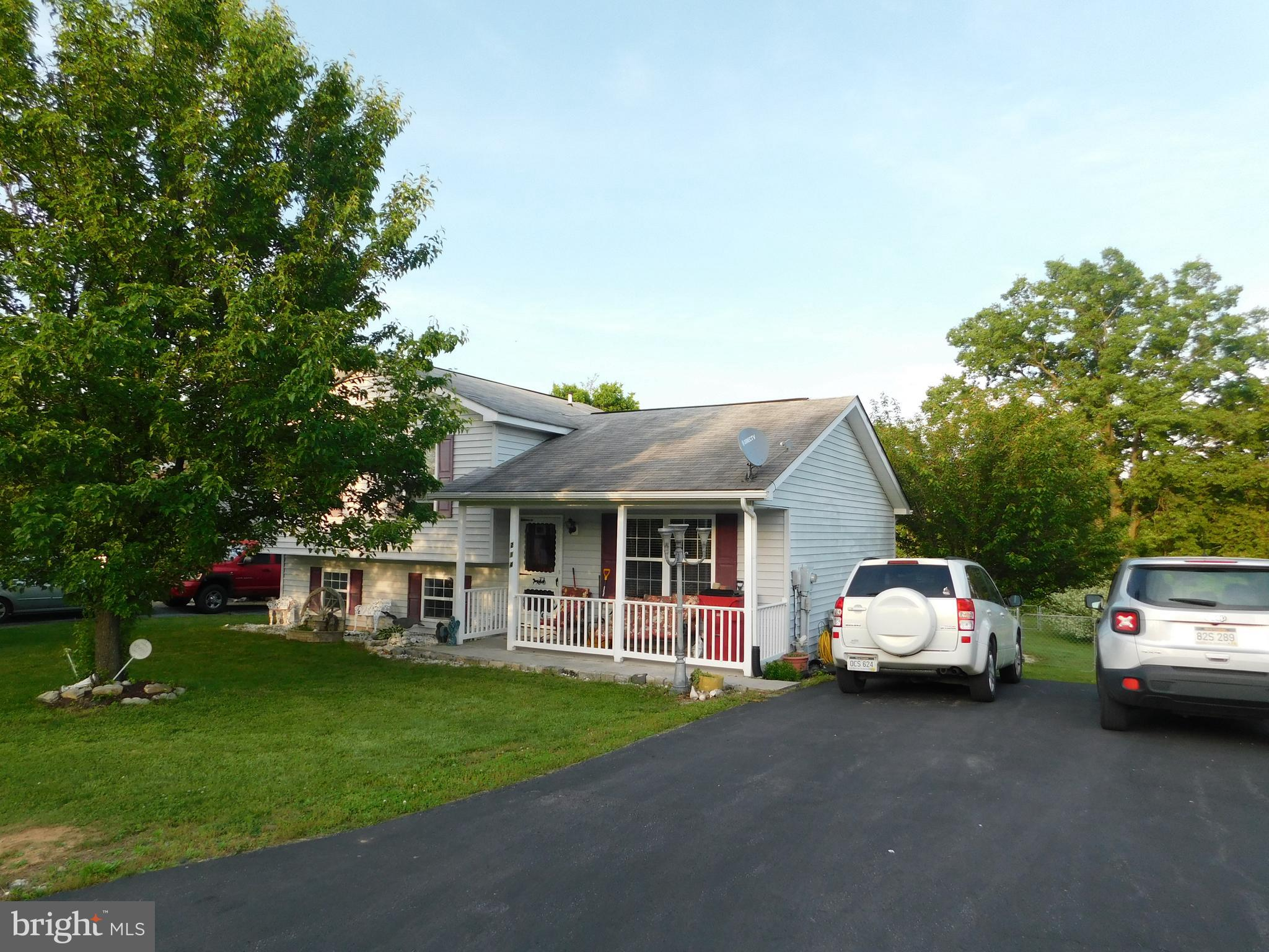 Come relax on the covered front porch, inside offers main level living room and kitchen dining combo
