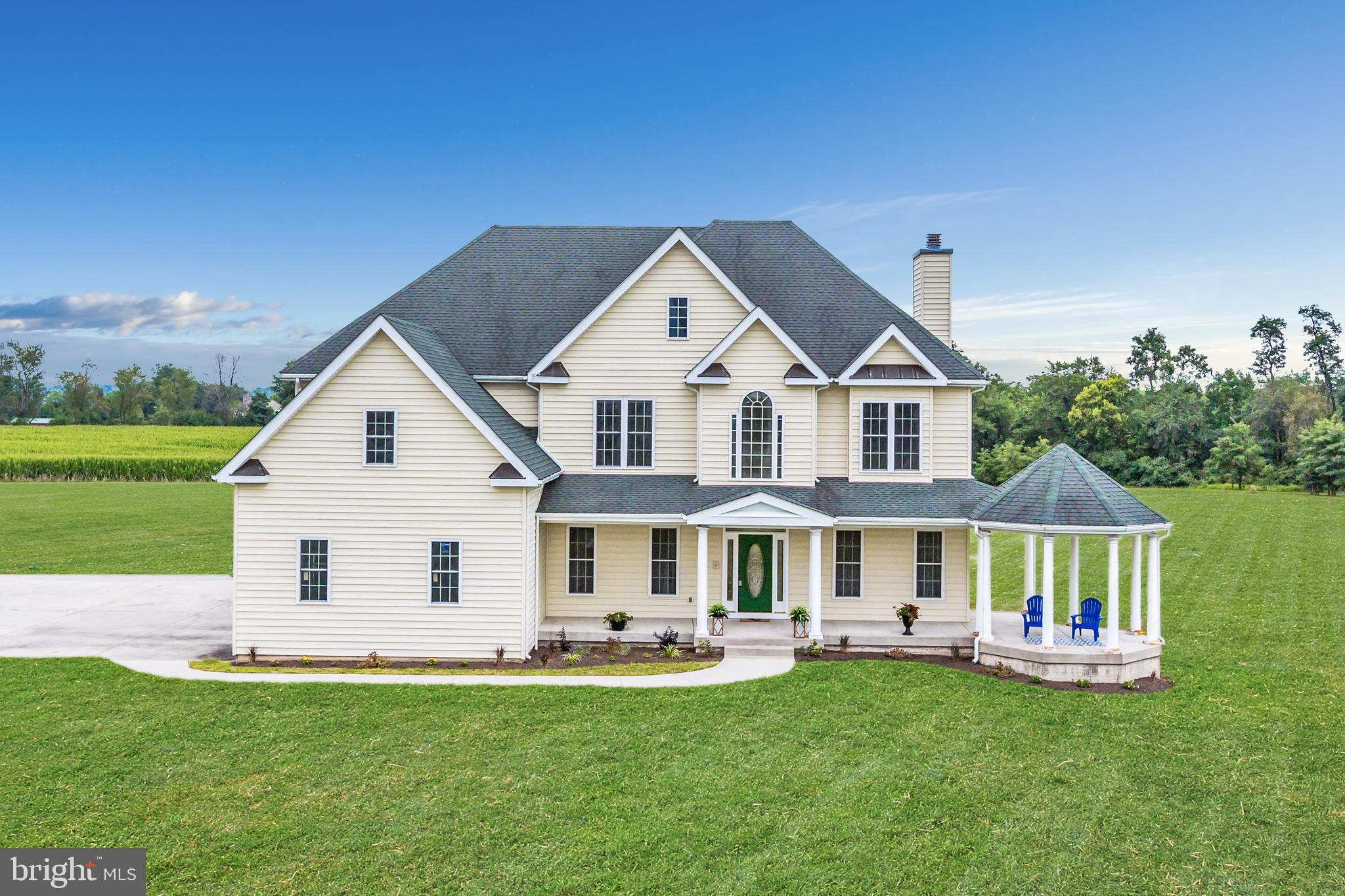 Turn-key and Gorgeous! Custom home sits on over 19 acres with views in every direction enjoying the