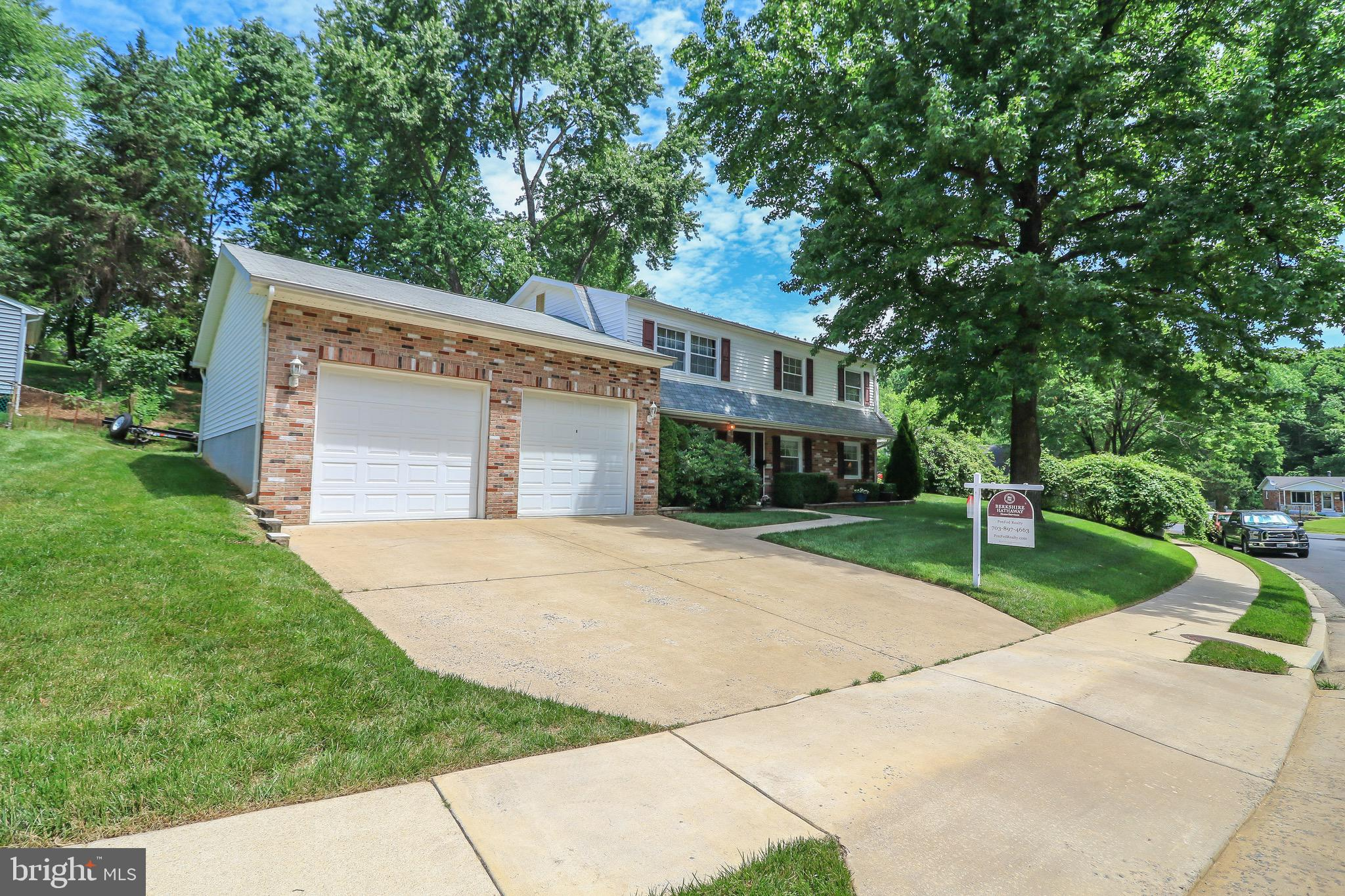 Make this first on your list to see! Over 2,100 finished square feet. Large family room and bedroom with full bath on main floor. Three bedrooms upstairs with second full bath. Large living room steps into updated kitchen with stainles appliances/granite/backsplash. Extension off kitchen for formal dining room. Laundry located off kitchen in large mud room with pantry/storage, steps out to covered deck and pool. Attached large 2 car garage (26X23) with vaulted ceilings has room for a lift. Minutes to shopping/Potomac Mills/Stone Bridge at Potomac Town Center/I-95/Quantico/Ft Belvoir/VRE