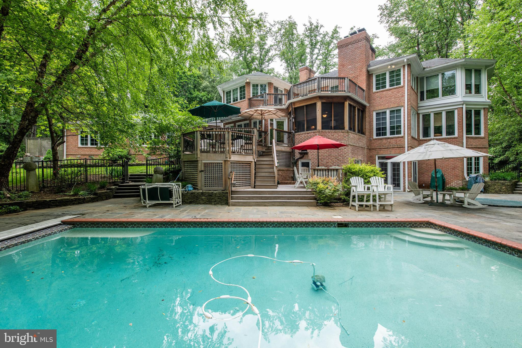 Relax and entertain indoors and out in the incredible living spaces of this sun-drenched all brick h