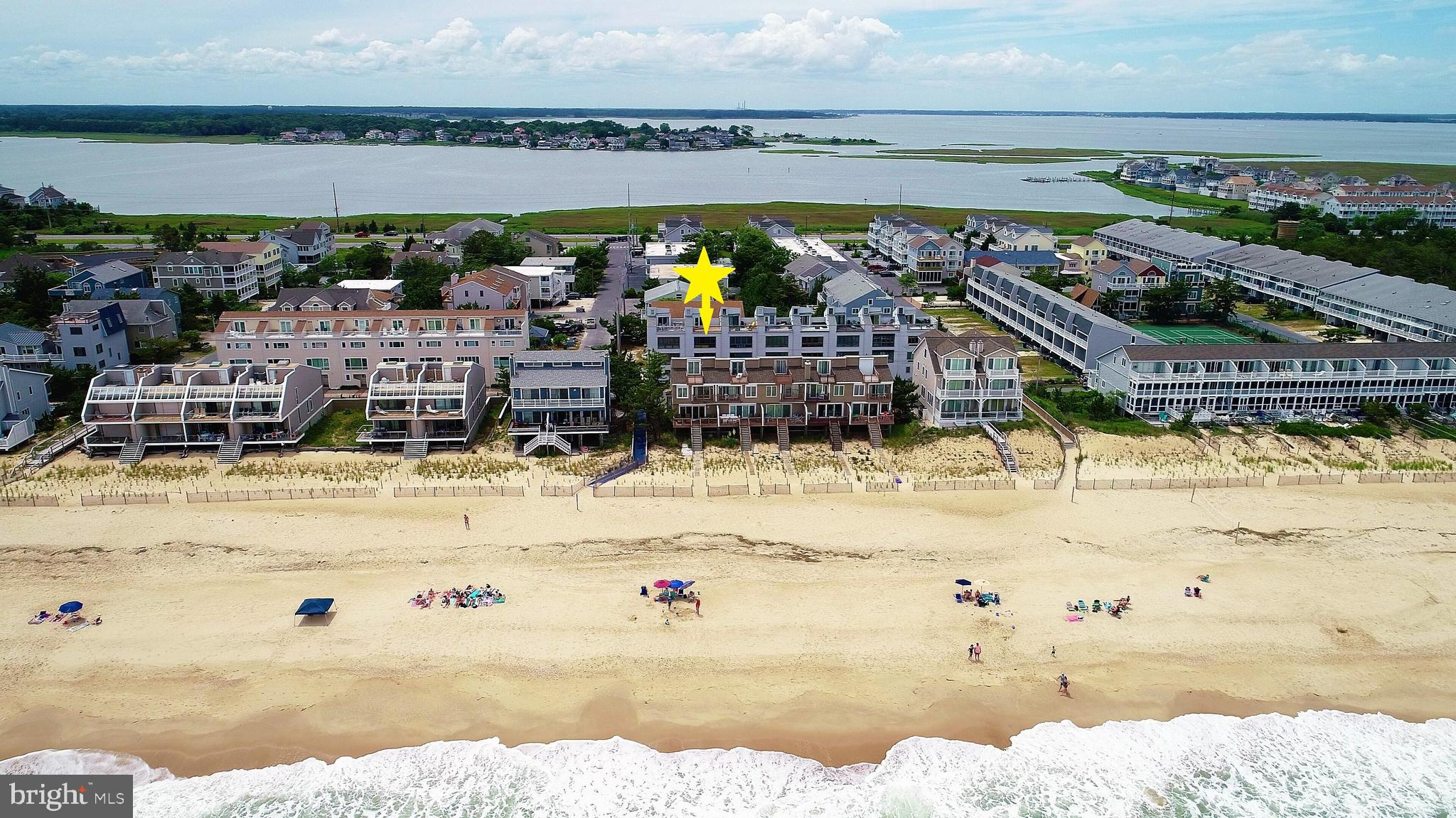 Located in Tower Shores, one lot off the ocean and only steps away from one of the area~s most prist