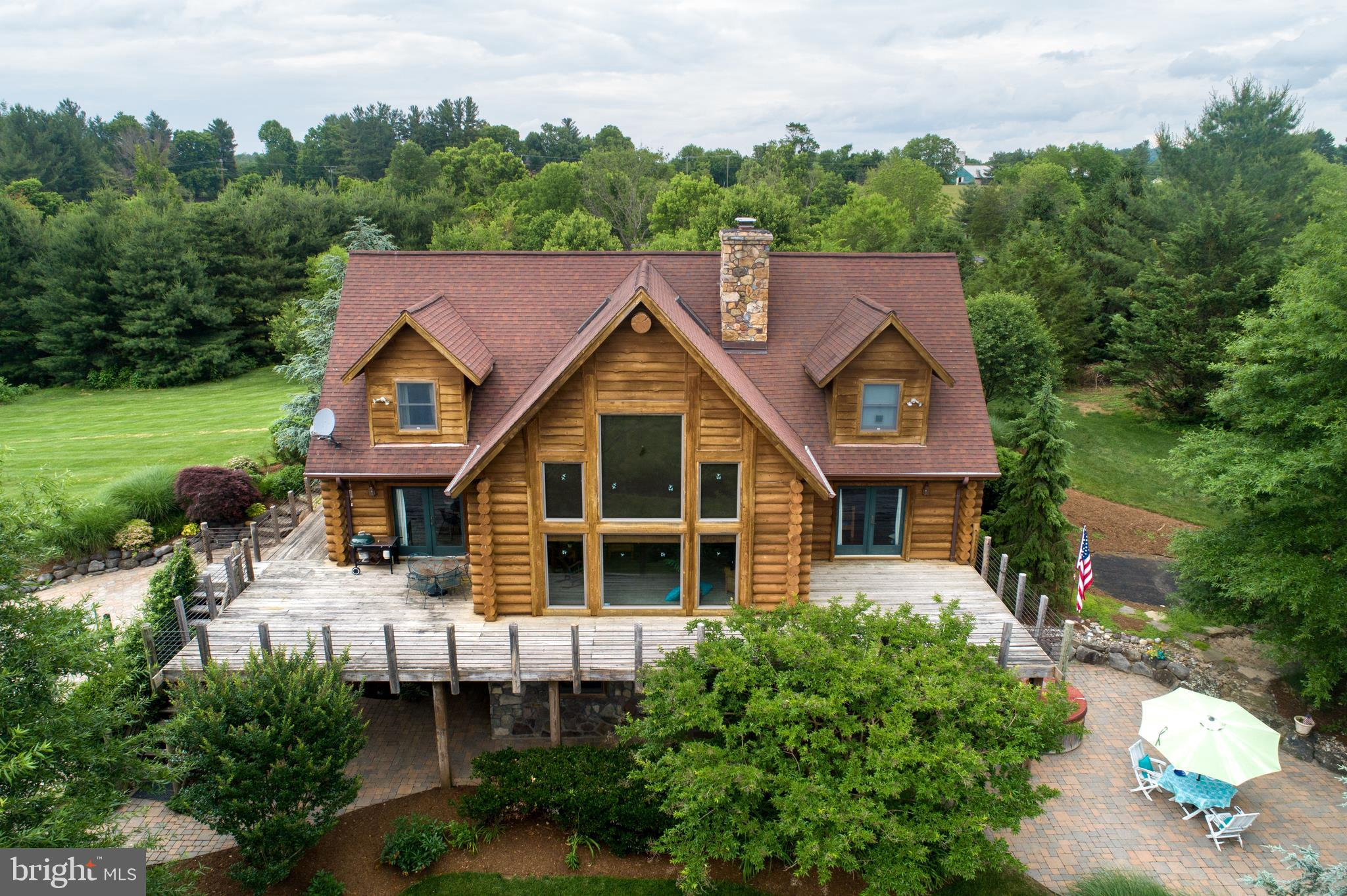 EXTRAORDINARY 4 BR LOG HOME--LIKE BEING ON VACATION IN PRIVATE 5 ACRE SETTING  W/YEAR-ROUND STREAM.  EXTENSIVE HARDSCAPE, LUSH LANDSCAPING.  MAIN LEVEL MASTER SUITE W/SITTING AREA, HW FLOOR.   GREAT RM W/VAULTED CEILING & MASSIVE STONE FIREPLACE;  2ND STORY OVERLOOK OFF STUDY/PLAY AREA;  HUGE UL 4TH BR BEING USED AS HOME OFFICE.   MANY UPSCALE FEATURES.   LL W/FPL OPENS ONTO TERRACE;  IN-LAW OR AU-PAIR POSSIBLE.  GARAGE W/WORK AREA PLUS HUGE SHED W/LOFT WHICH COULD BE USED FOR ANIMALS.  EASY COMMUTING & NEAR ALL AMENITIES.  ****$10,000 BUYER CLOSING CREDIT****QUICK SETTLEMENT POSSIBLE***MOTIVATED SELLERS***