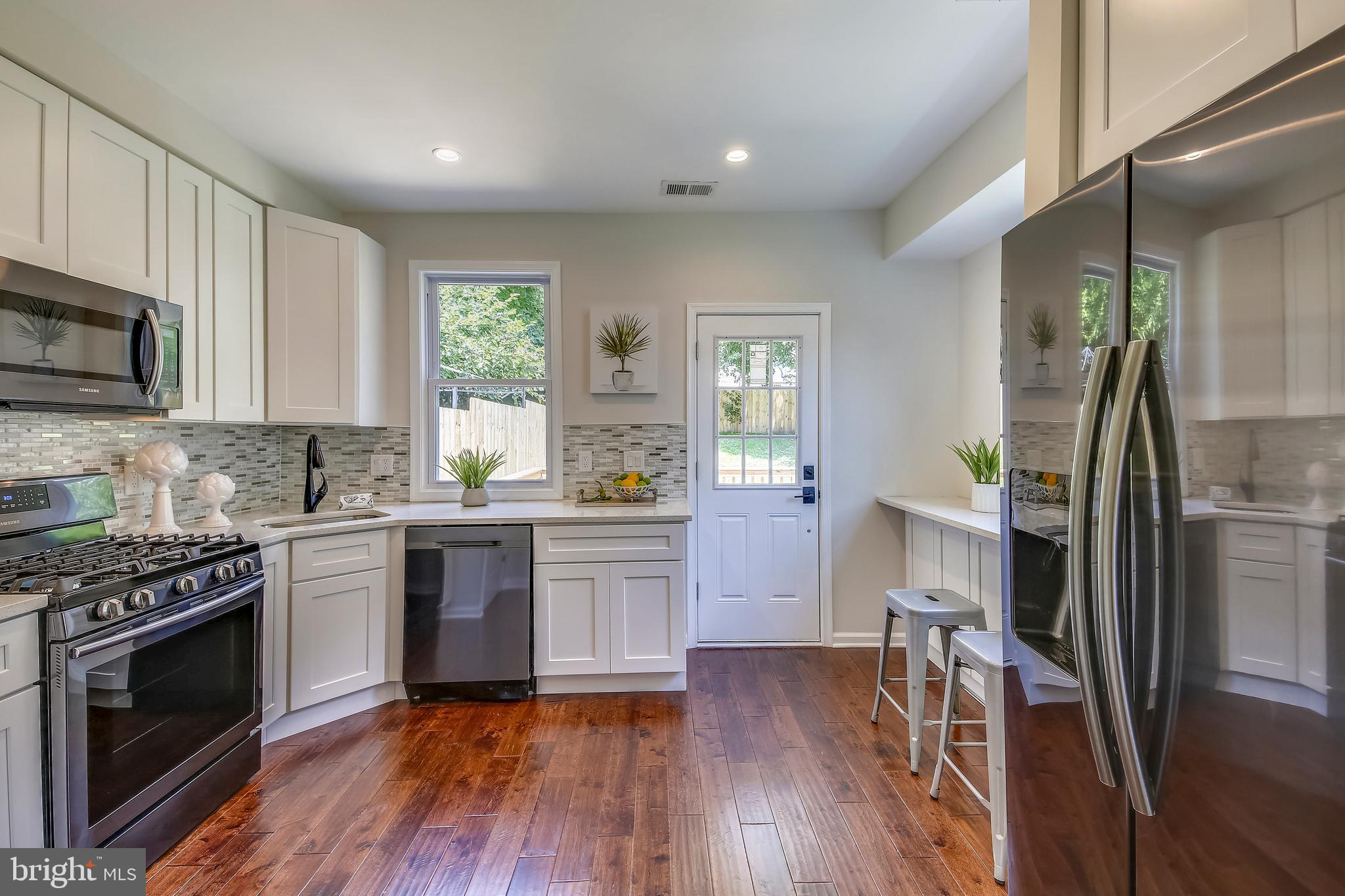 Gorgeous fully renovated home in Deanwood with 2 beds and 1.5 baths waiting for you! Everything is n