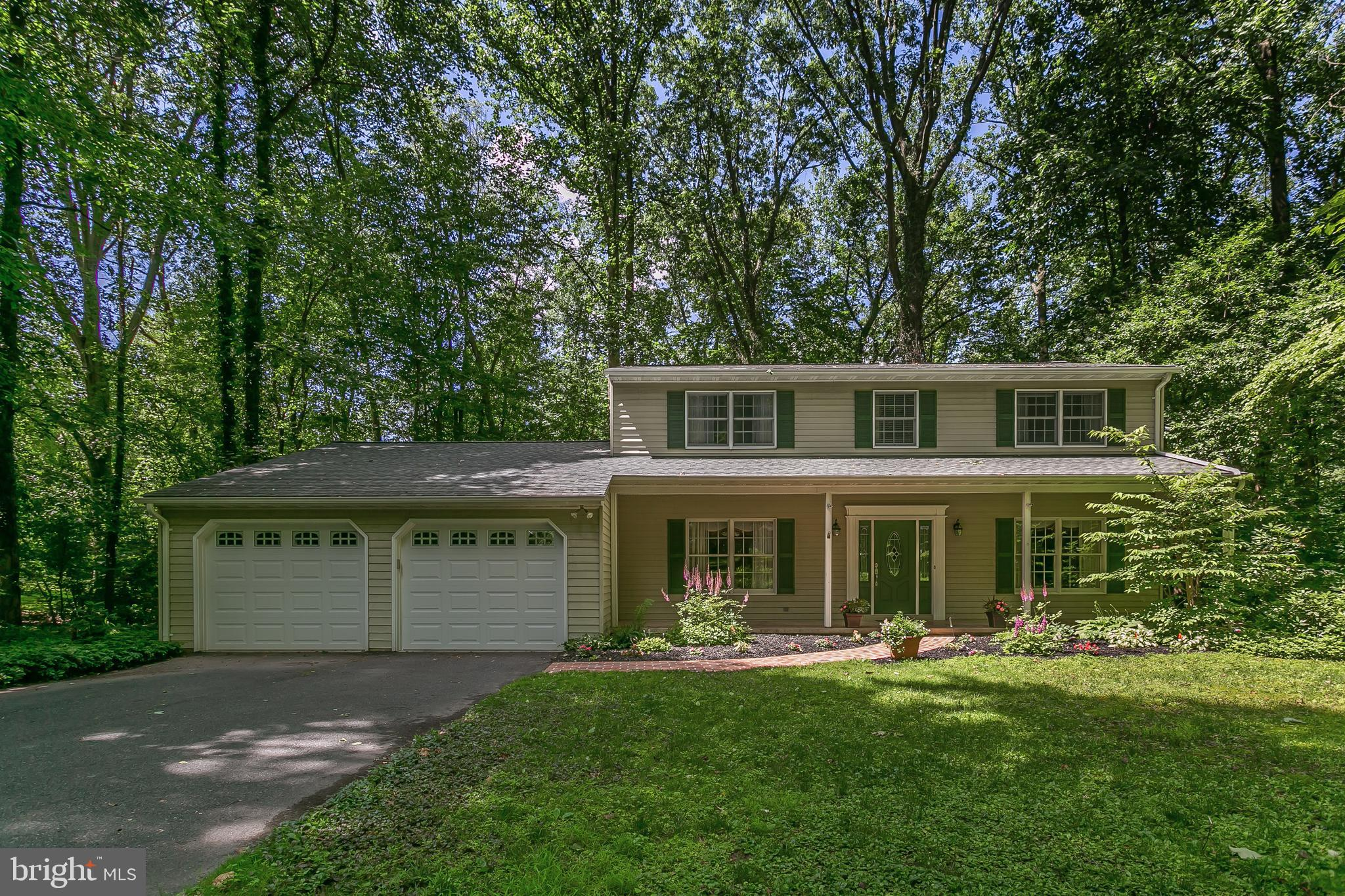 Welcome Home to your Rolling Green Porch Front Colonial.  Curved brick walkway and beautiful landsca
