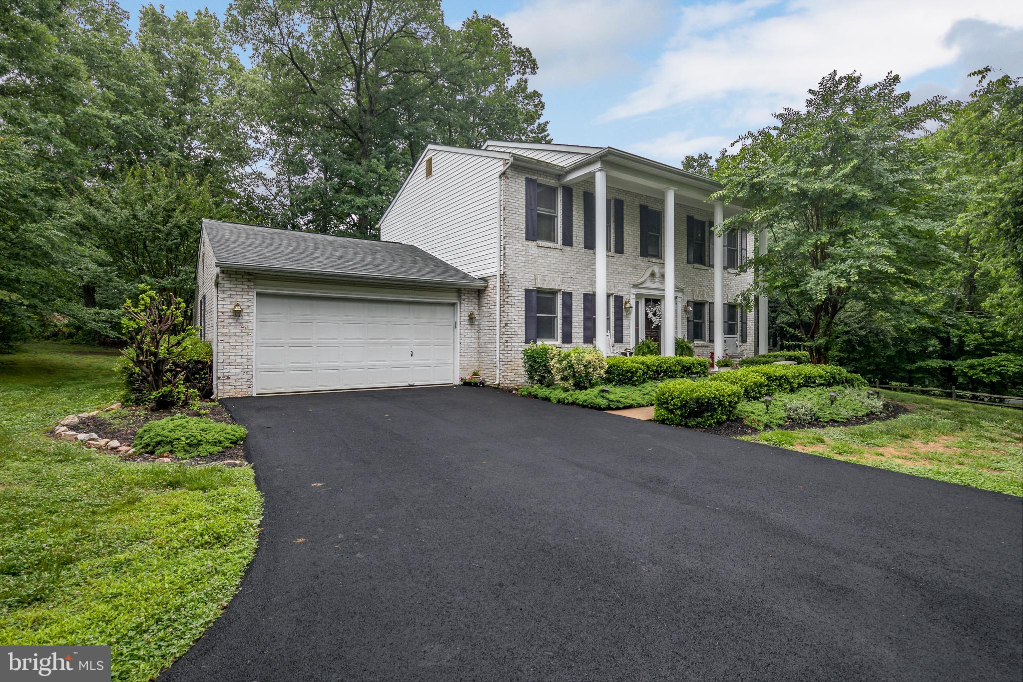 This stately colonial offers 4 spacious bedrooms, 2.5 baths, 2 car garage and room to grow in the basement. Beautiful hardwood floors in the formal living room, dining room and foyer. You will love the recently remodeled kitchen with granite a large center island and newer appliances. The kitchen extends to a huge eating area and oversized family room. A large master and 3 more spacious bedrooms on the upper level. Enjoy the deck over looking the private back yard. Original owners selling the formerl model.  Upgrades include new paved driveway, new roof in 2016, newer HVAC, Hot water heater, newer dishwasher, freshly painted exterior,
