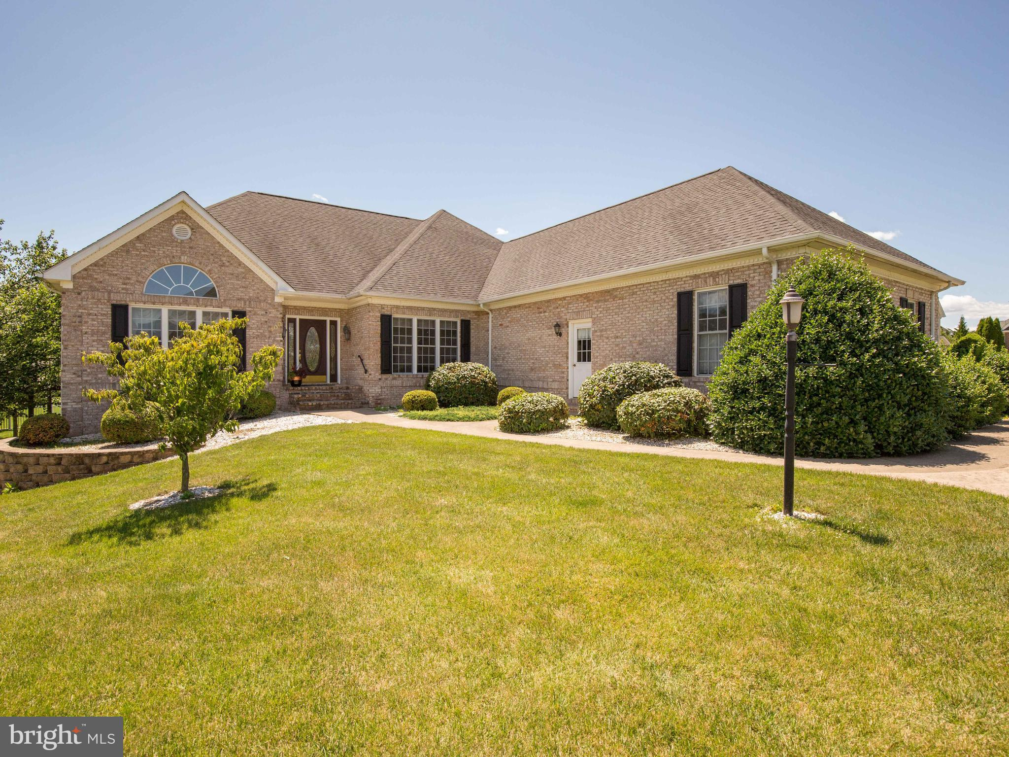 WOW!   This spectacular all brick rancher located in desirable Raven Pointe is a commuter's dream wi
