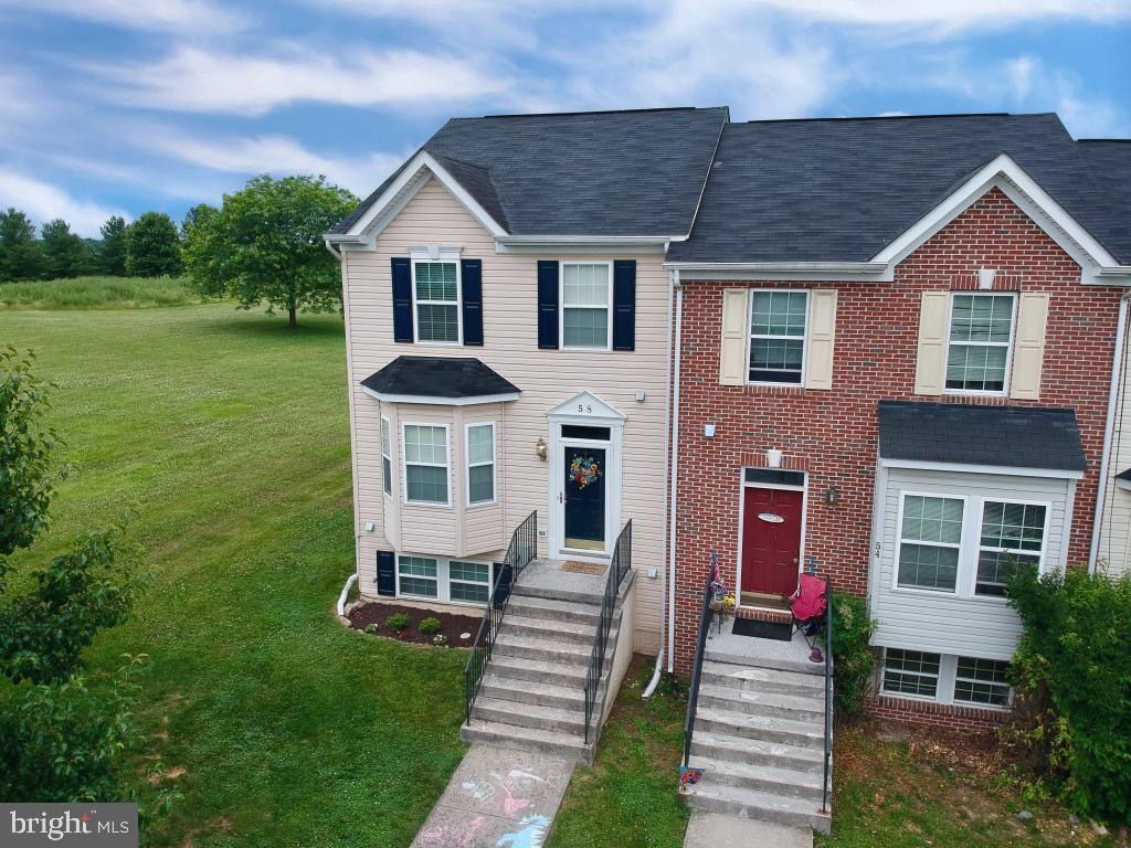 Charming well maintained END unit Townhouse in the Fairways of Stonebridge.  The open kitchen with a