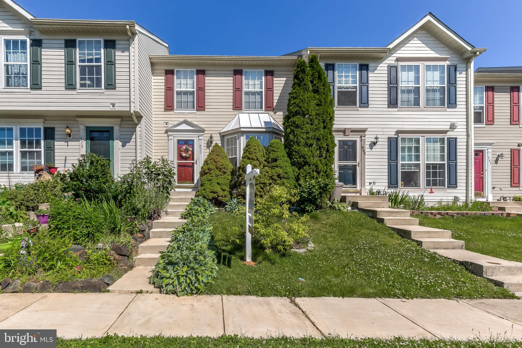 Classic charm and comfort await you in this picture-perfect three level townhome! Enter your new hom