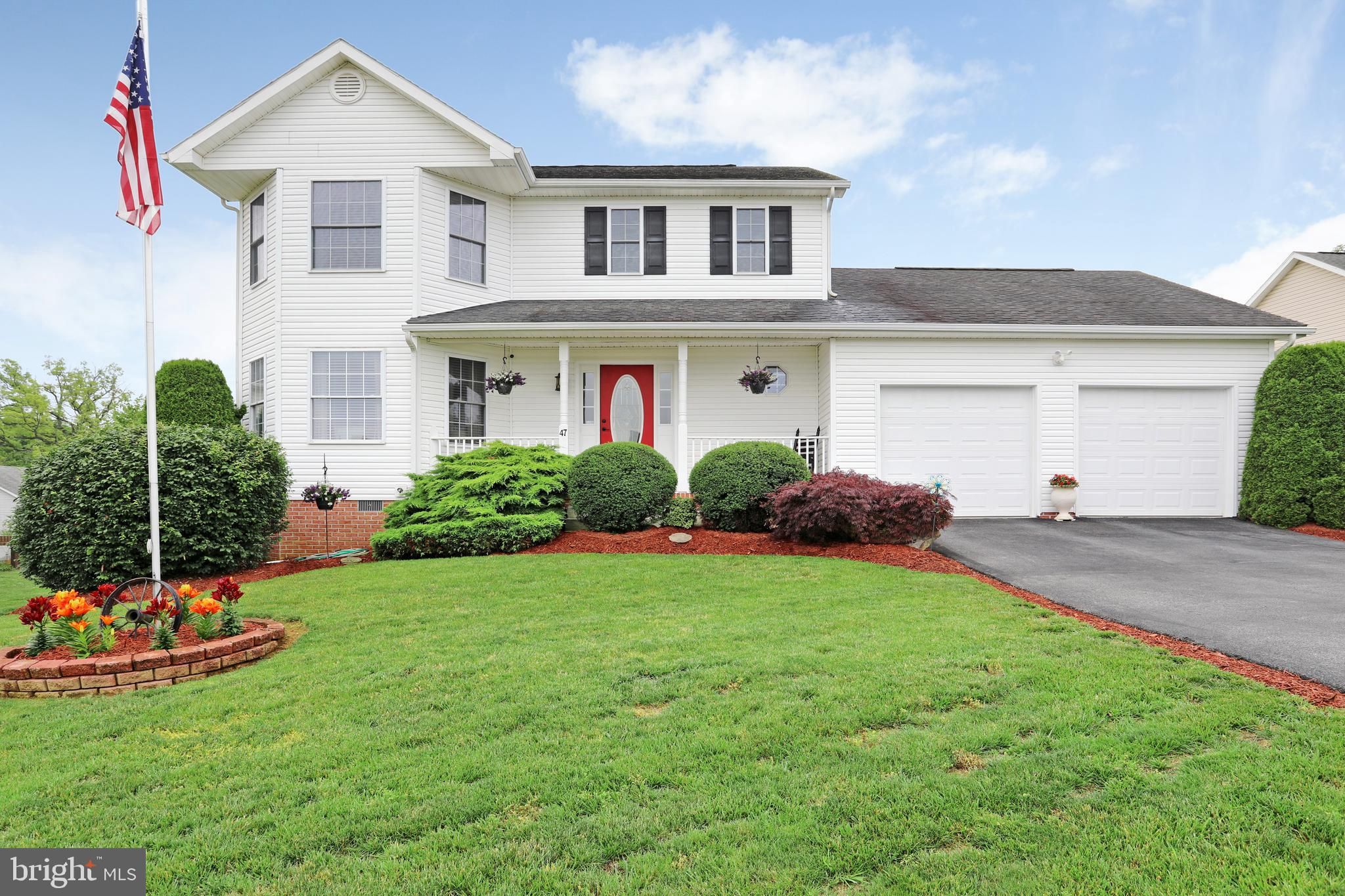 Gorgeous curb appeal is just ONE of the things you'll love about this home. Situated on a cul de sac