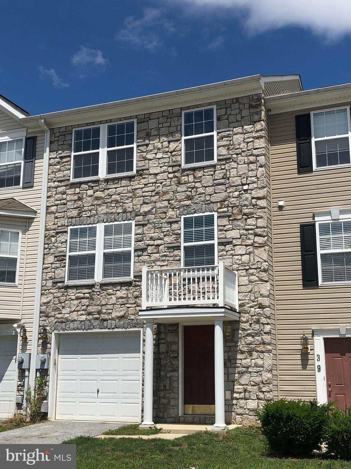 Well maintained 3 bedroom 2.5 bath townhouse. Newer hardwood floors throughout the main level and ha