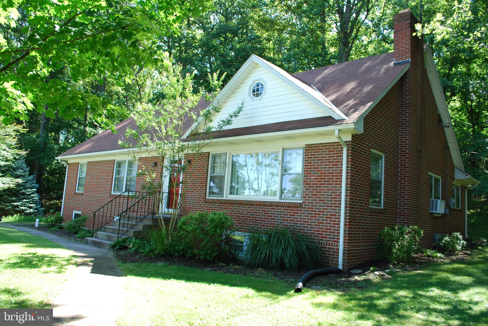 Lovely home on wooded lot near Westminster with easy access to commuter routes. All brick, 5 bedroom