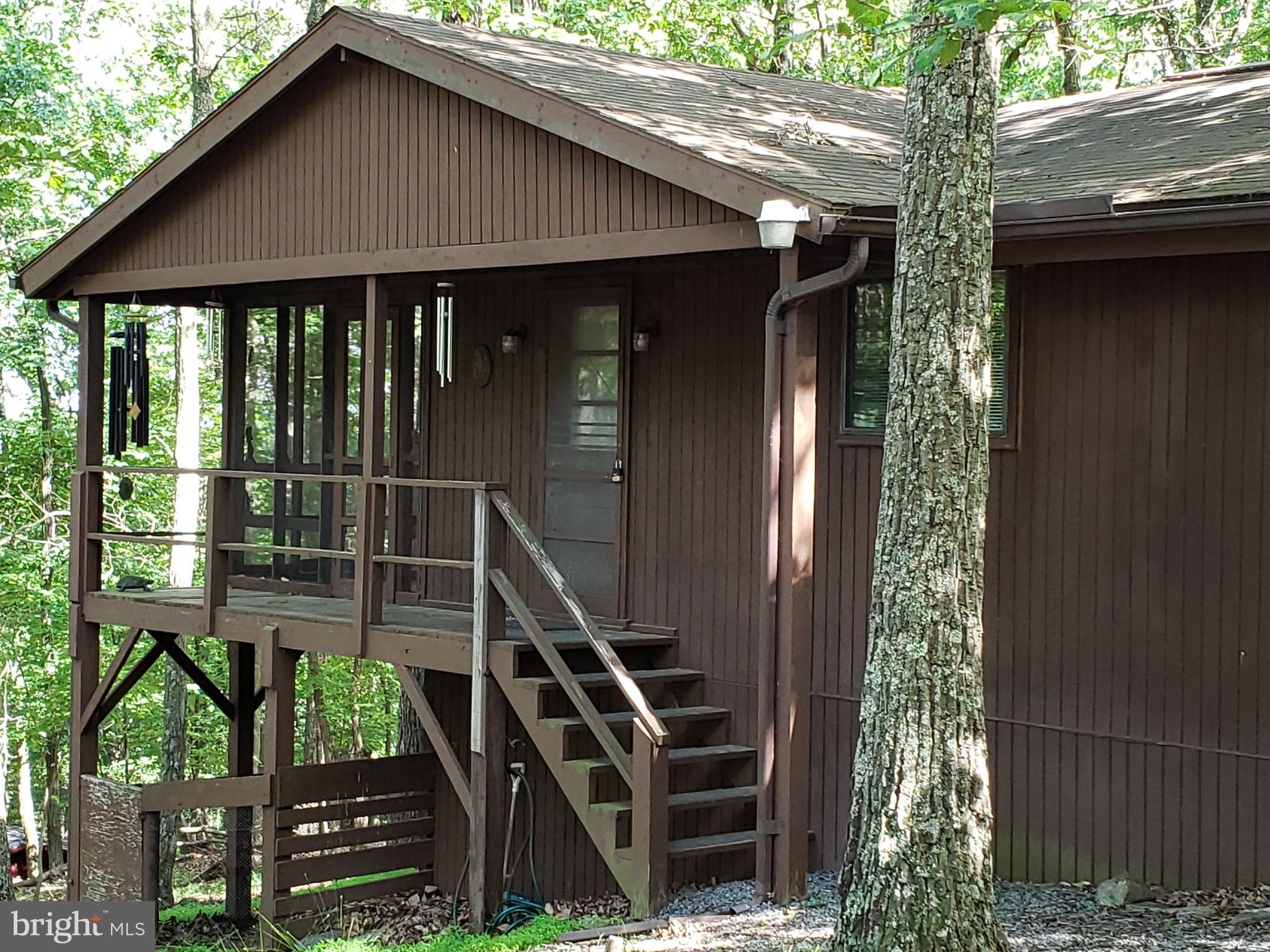 Cozy cabin/cottage to enjoy full time or part time in the woods.  Three bedrooms with one being used