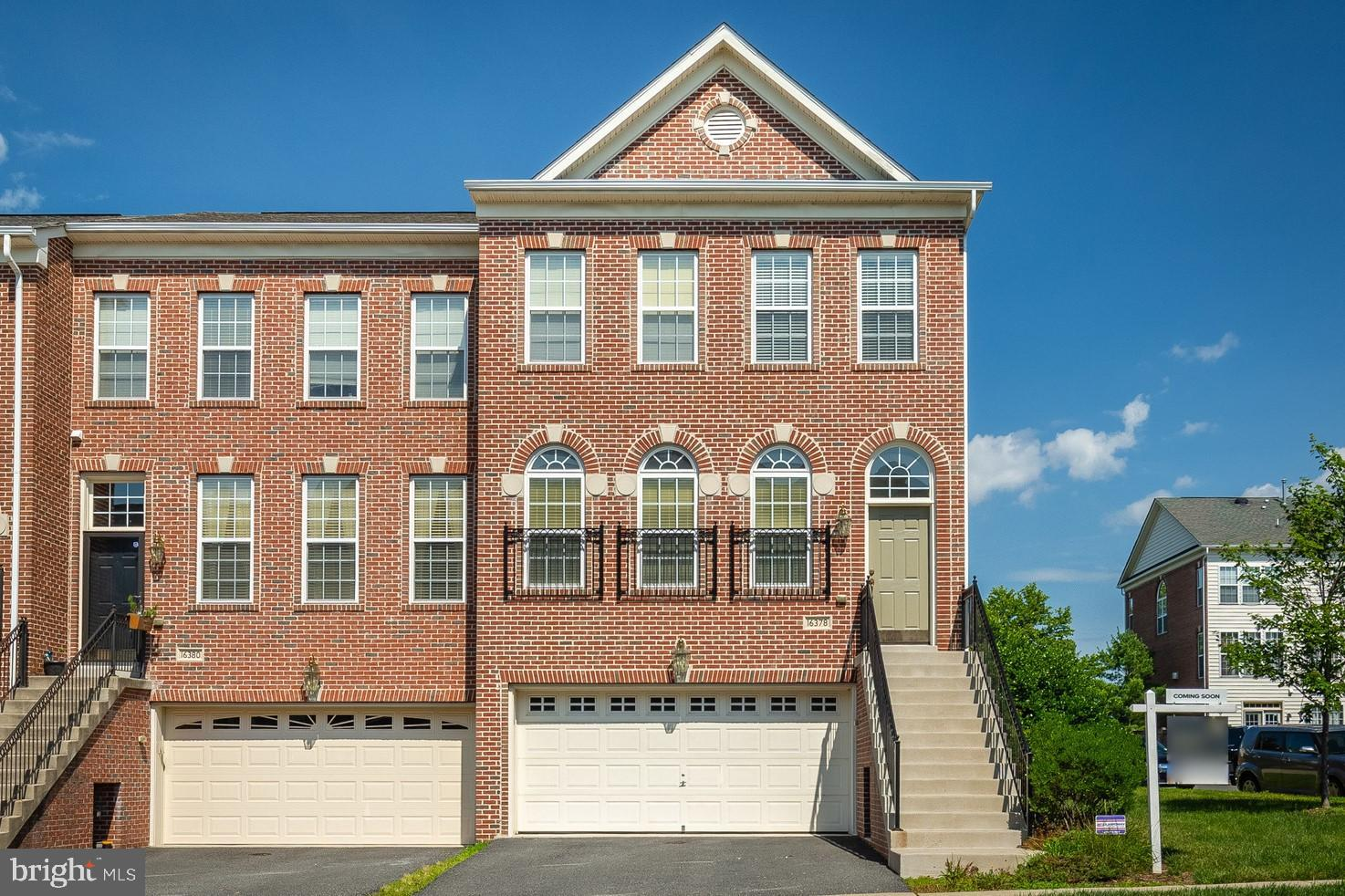 PRISTINE THREE-LEVEL END UNIT READY FOR QUICK CLOSING**TWO-CAR GARAGE** BRICK FRONT AND SIDE**SPACIO