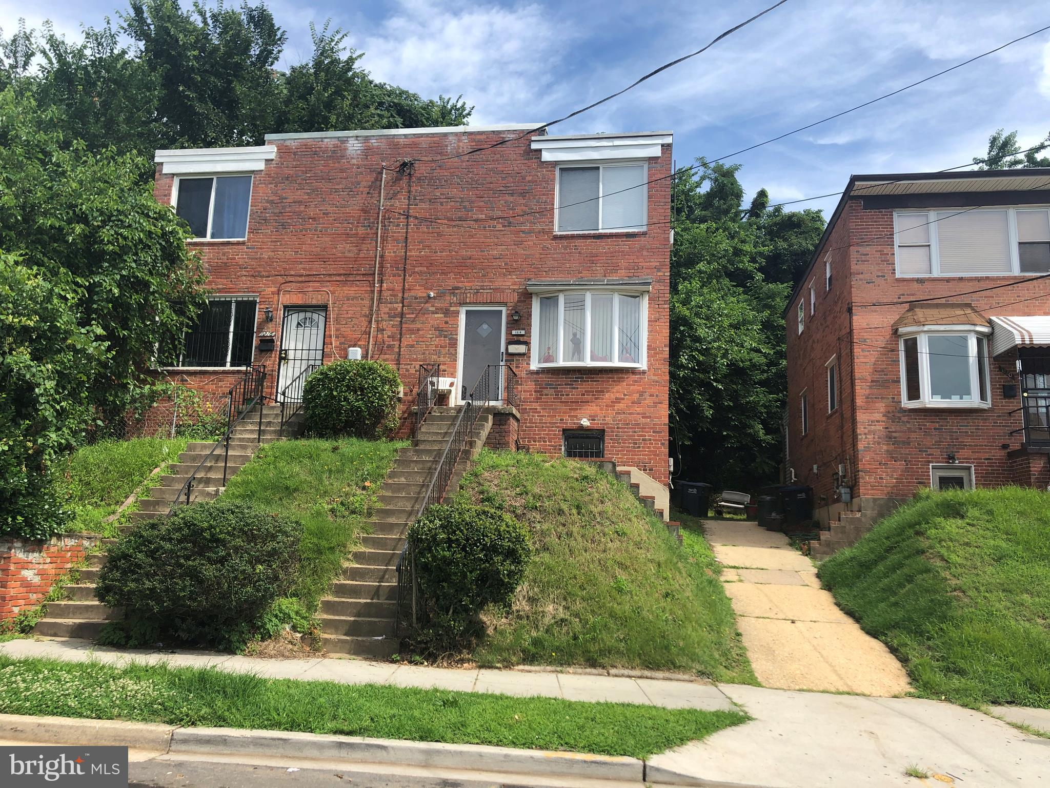 Come view this brick home located on a quiet tree lined street in Congress Heights. This area may be
