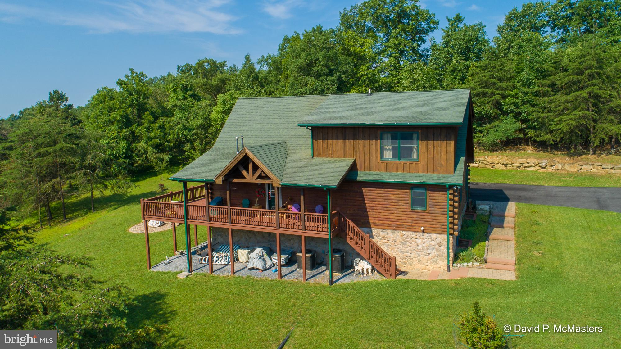Need an escape?  Retreat to this stunning, custom log home nestled in a beautiful setting, within th