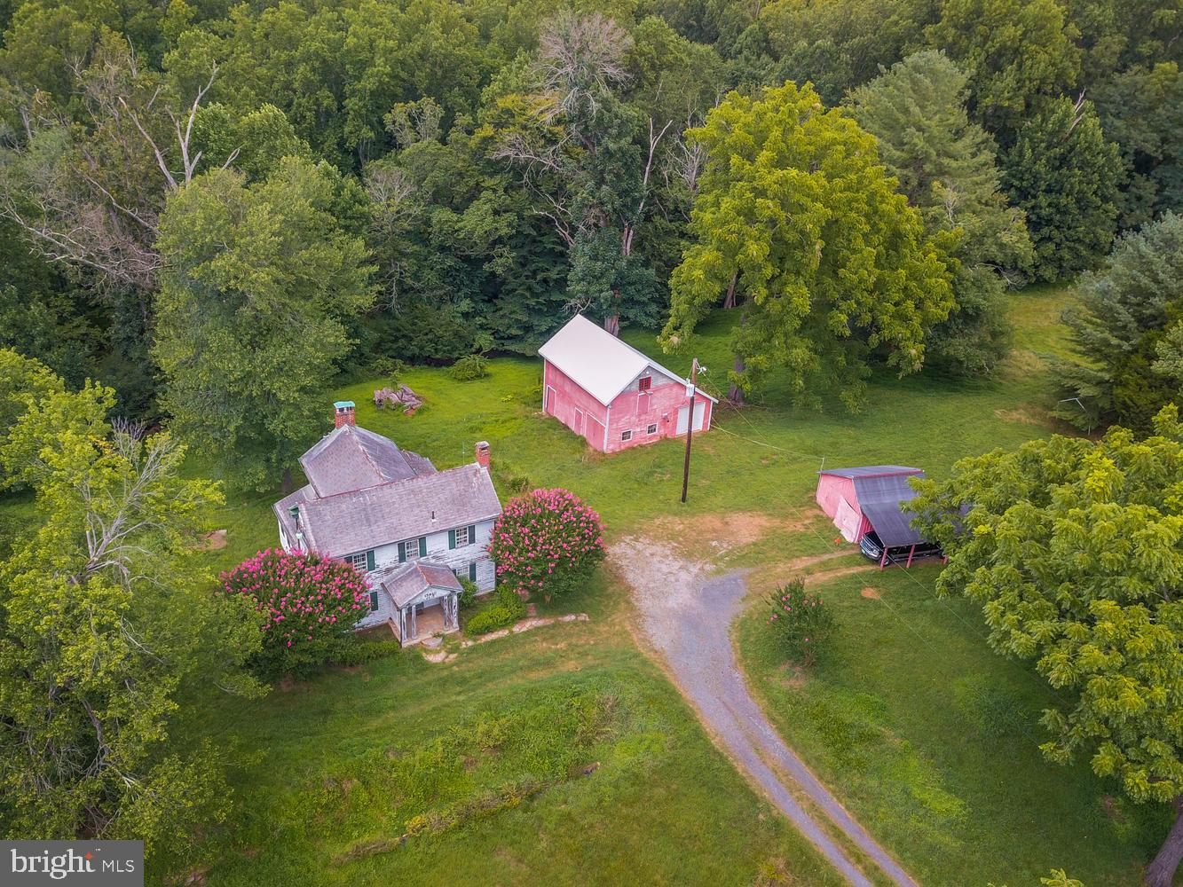 "Own a piece of history! Built in the 1800's! This unique property known as the ""Nathan Shaw House"" is on the Maryland Historical list. The almost 5 acre lot may be able to subdivided. There are several out buildings included. The property is being sold As-Is. Use extreme caution when entering property. Bring your decorative touch and ideas to this property! Just needs some TLC!"