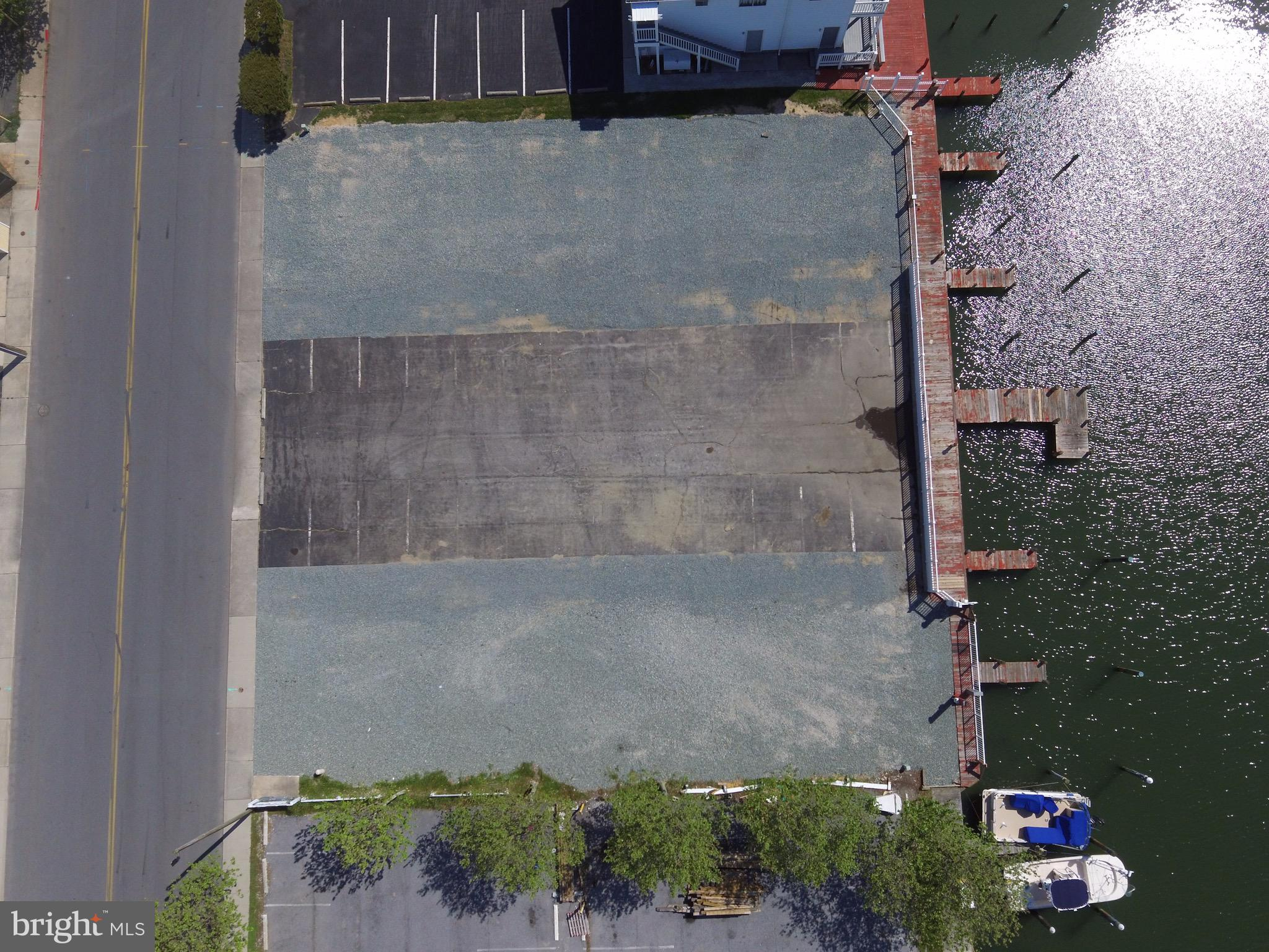 Great opportunity to own 1 or 2 lots-125 and 126 on the waterfront in Downtown Ocean City. 16,250 sq. ft. of LC1 commercial zoned property on Herring Way. This was part of the Islander Motel and the owner demolished the buildings and manicured the lot for easy redevelopment for new owners. Fencing on the bulk headed waterfront has been replaced by owner and currently has 9+boat slips-4+ per lot- for use by the new buyers. 1 water/sewer hook ups at each the property. Creative owner financing with approved credit with minimum down payment & possible deferred payments with a balloon payment due when negotiated. Lots can be sold separately at $600,000 each. Each lot has its own water and sewer connection. Call listing agents for details.