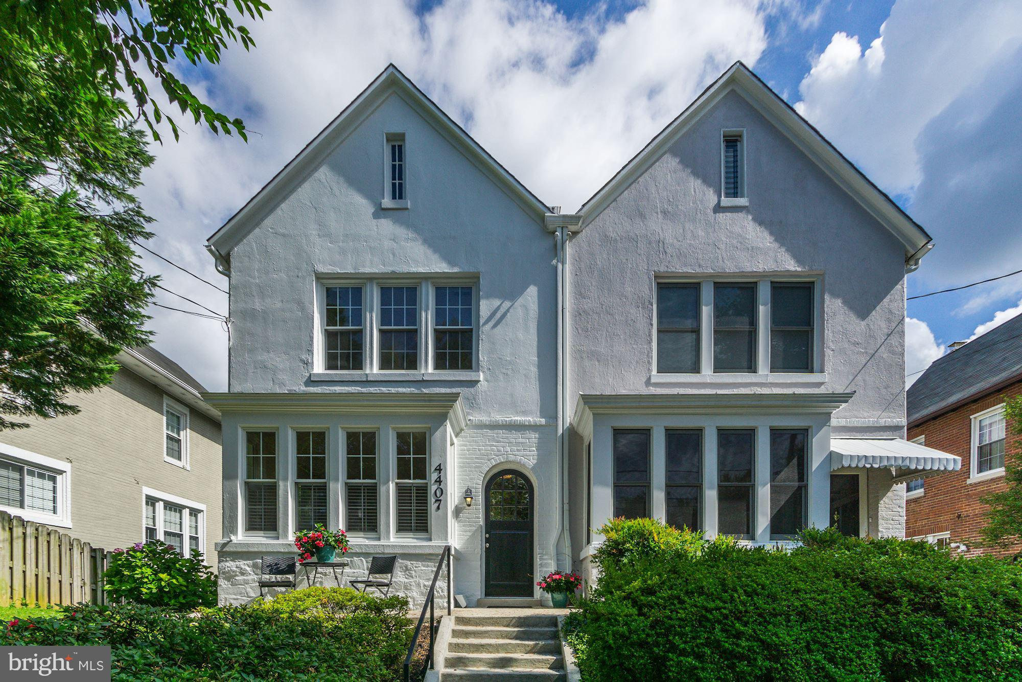 This attractive home offers 4BRs/2.5BAs with a gracious floorplan, gleaming hardwood floors and wall