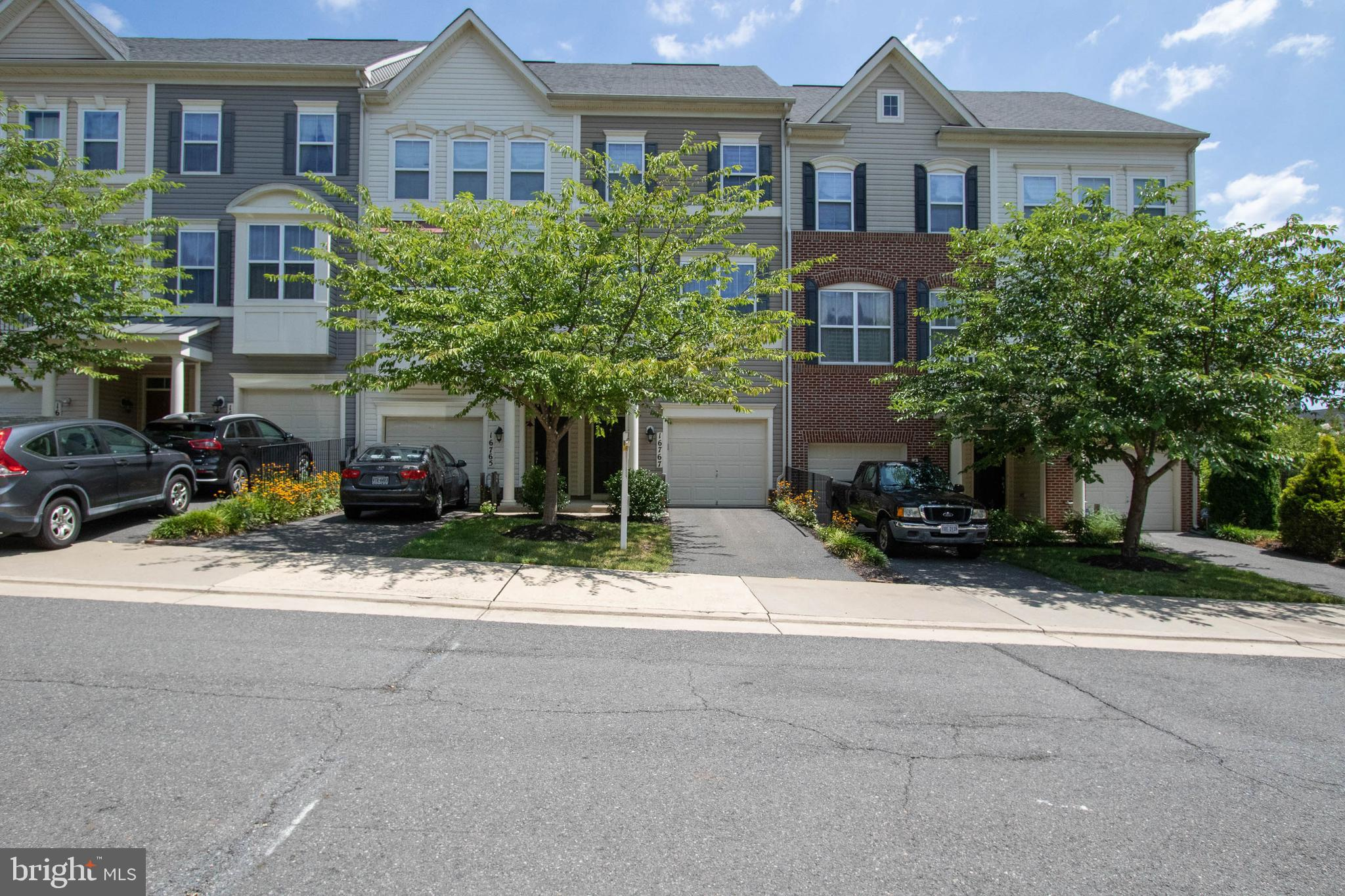 Fantastic 3 Level Garage Townhome in Excellent condition! Granite counters, kit island, hardwood flo