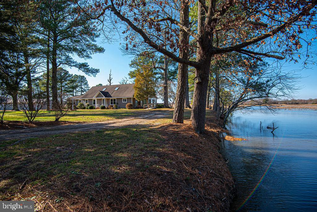 This waterfront property on the Wicomico River could be YOUR slice of heaven. The private peninsula