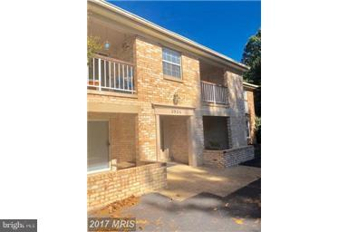 Fully remodeled ground level unit with private patio backing to trees! Granite counters, Stainless S