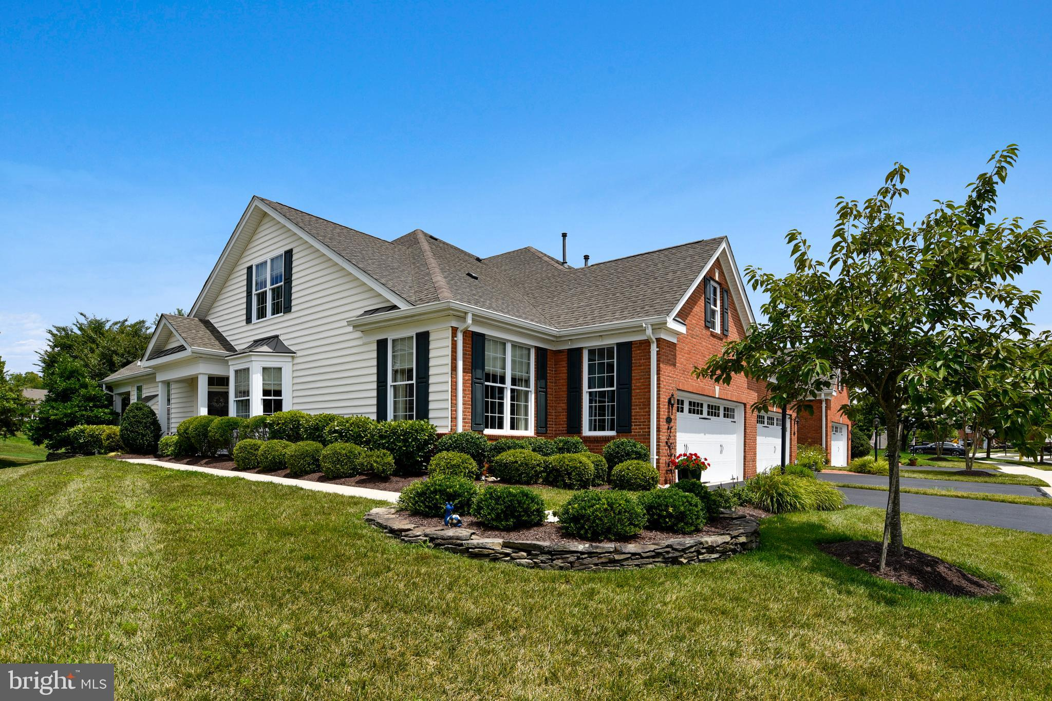 VILLA style home on the 9th Hole of this community exclusive Arnold Palmer Golf Course! This elegant