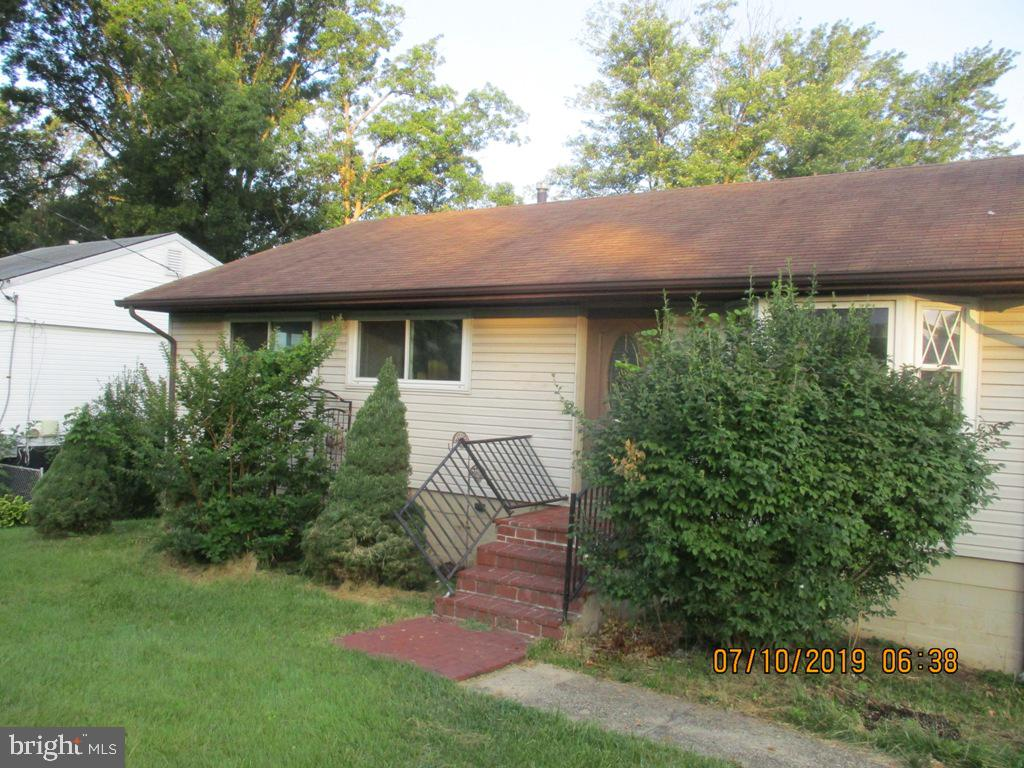 Rambler with hardwood floors throughout main living area. Deck off of kitchen and storage shed in th