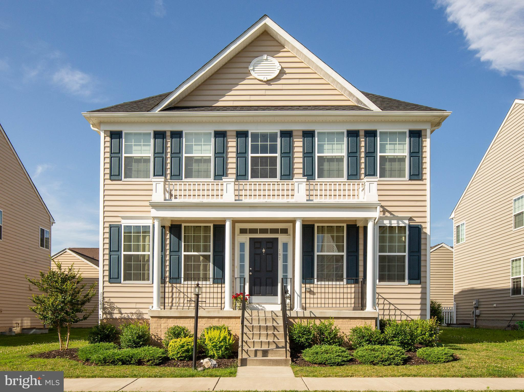 Sunny, open five-bedroom colonial with a lovely neutral color pallet throughout just off commuter ro