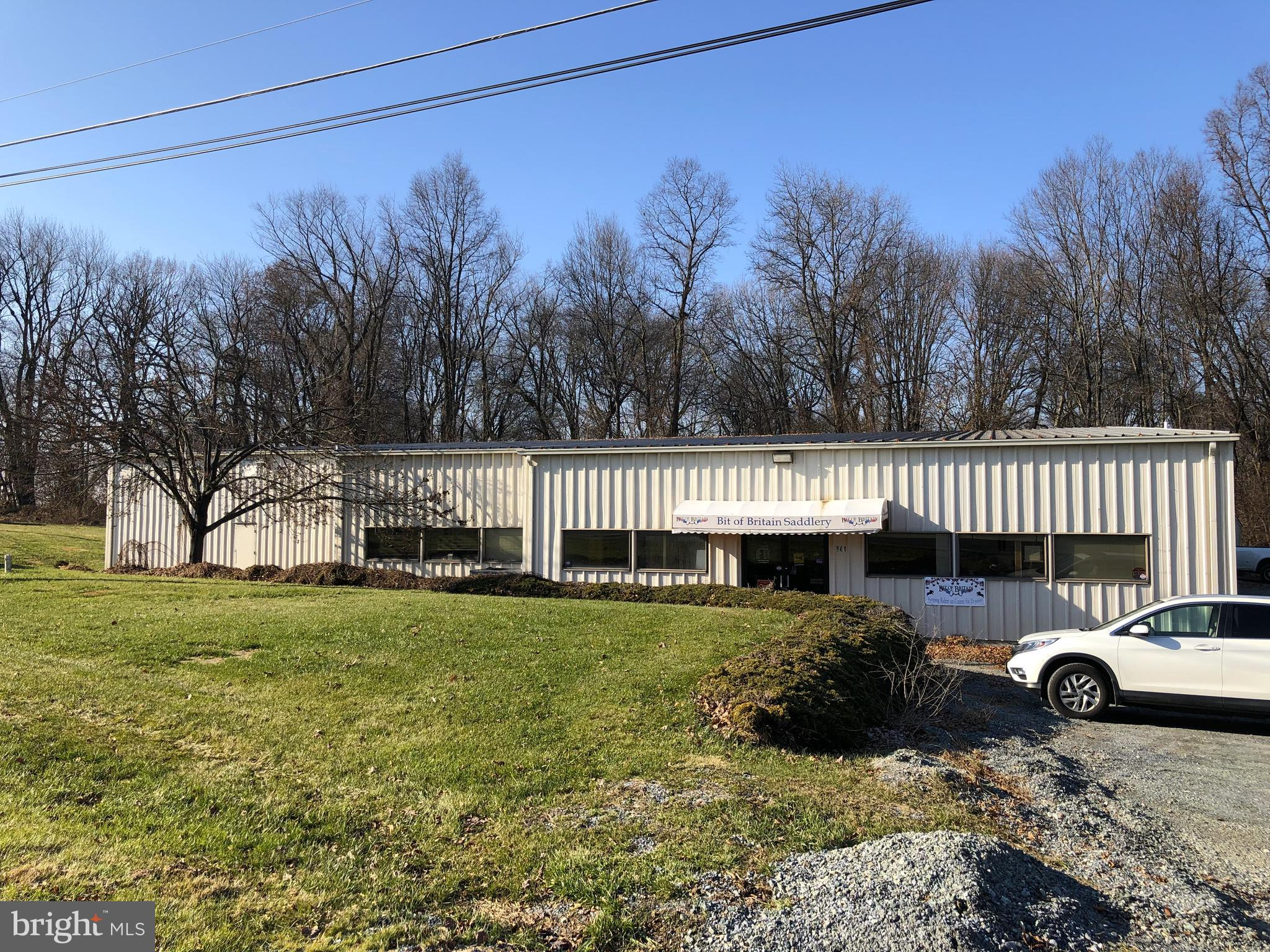Sizable Industrial Flex/Warehouse Commercial Building conveniently located just off US1 in Lower Oxford Township. Property is being offered for sale (Bright MLS#PACT484928) or NNN lease. Divisible into two suites with common area included in both spaces with access to overhead dock door. Great Signage and visibility from US-1. Ample Parking. 3 Phase Electric available. Central A/C in the Office. Warehouse SF: 5,410/Office SF: 1,080/Retail SF: 1,080 in current layout. Suite 1 layout would feature 5,496sf of Flex space and 540sf of common area access to the overhead door for deliveries/shipments. See Documents for Floor Plan. Suite 2 layout would feature 5,400sf Warehouse space, 696sf Office, and 540sf common area providing access to the overhead door for deliveries/shipments. Also known as 141 Union School Rd (USPS).