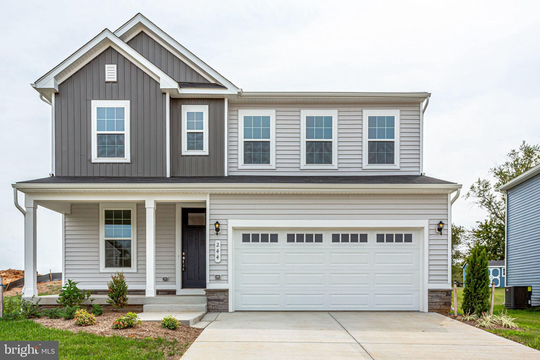 Move-in ready! This beautiful home welcomes you with a charming covered entry. Main-floor highlights