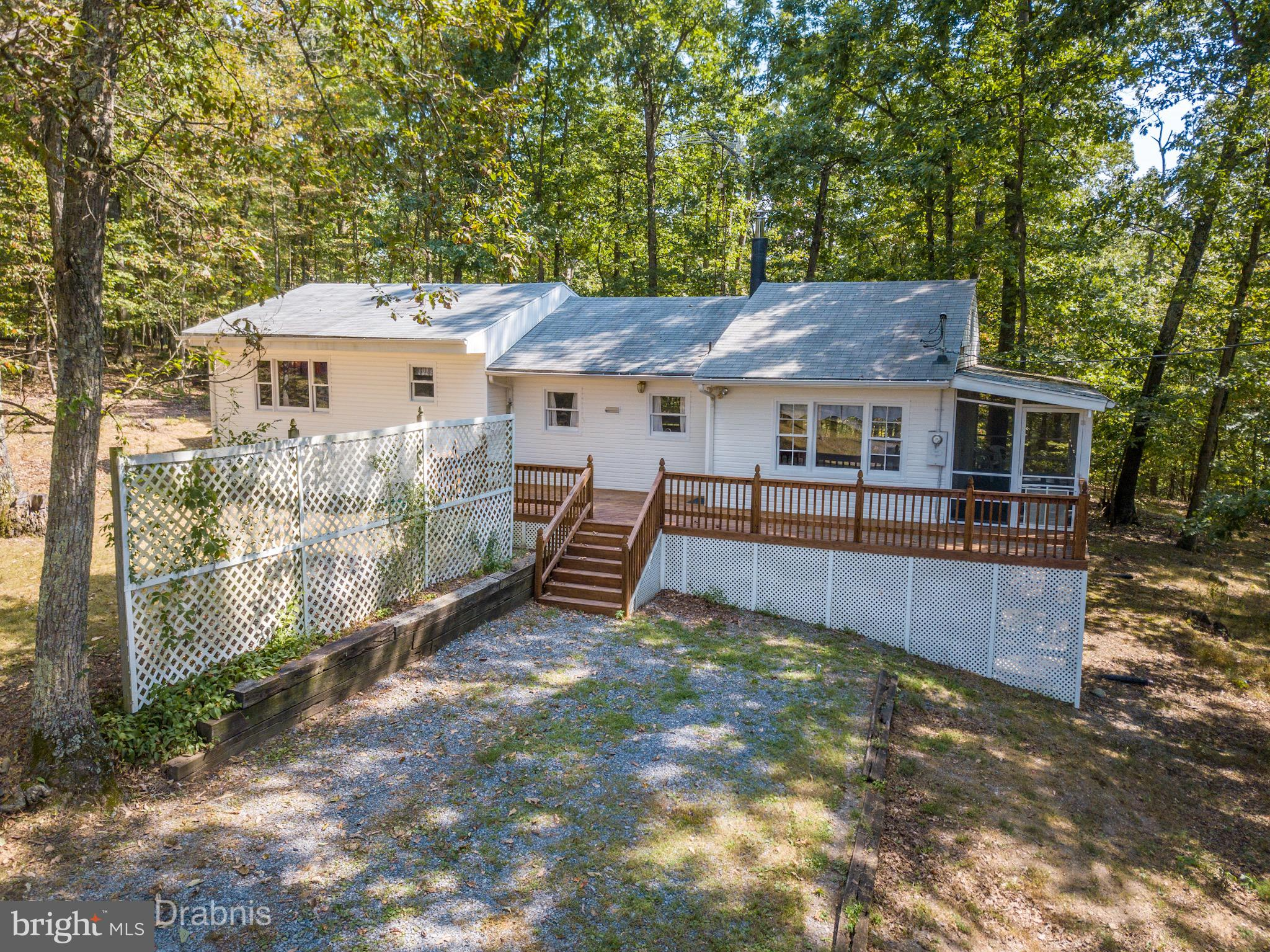 Remodeled 3 bedroom, 2 bath contemporary ranch on 2.64 wooded acres features easy care laminate floo