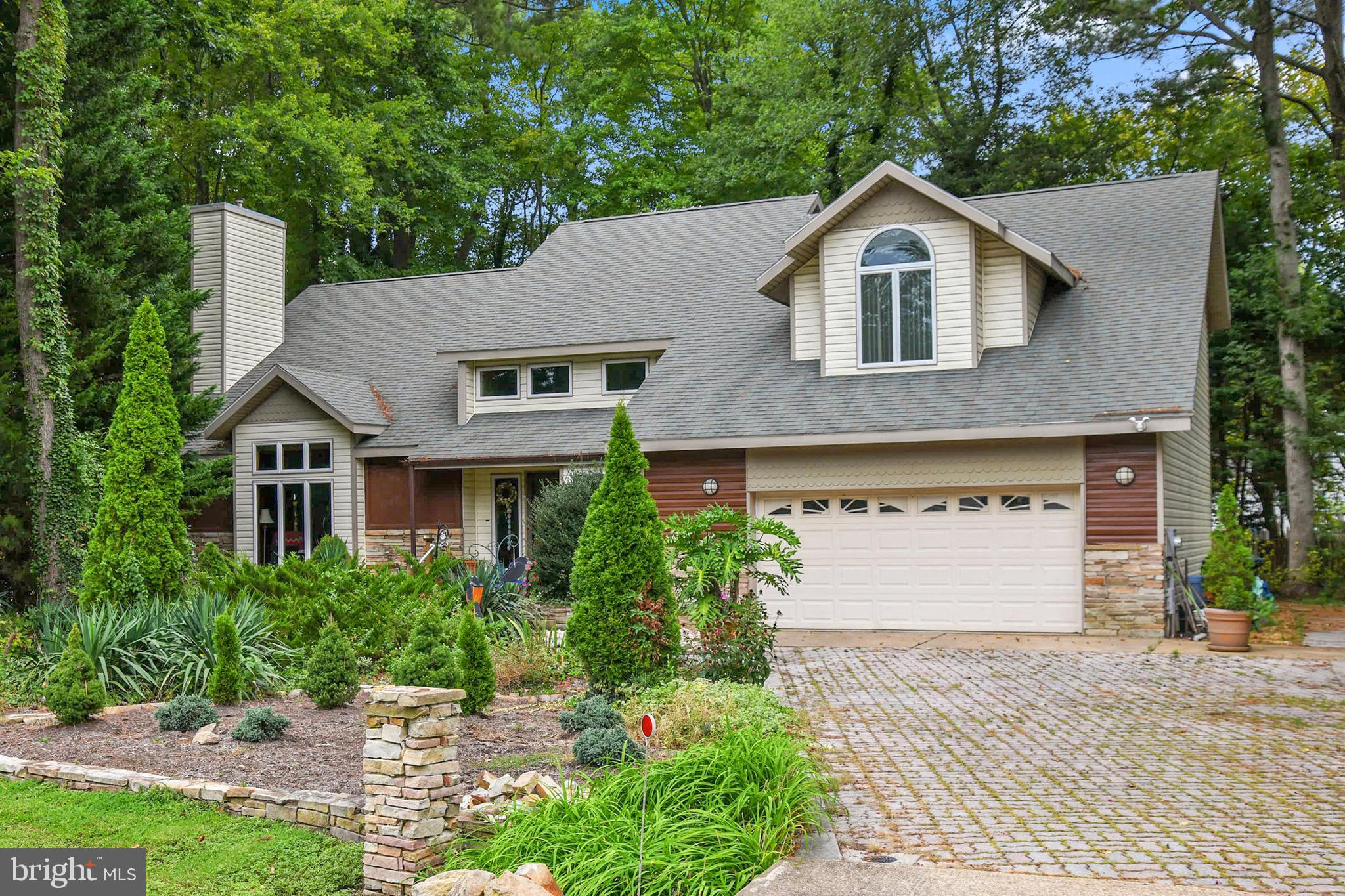 A 4 BD, 2.5 BA home on a pretty half+ acre lot is back on the market in Fox Chapel, a sought-after a