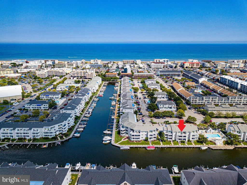 Completely renovated Waterfront Condo in Popular Hidden Harbour.  Large Outdoor Pool.  Deeded Boat Slip w/10K LB. (Sunstream) Boat Lift. Slip is on a wide canal can accomadate up to 30' boat.   Easy access to the Bay.  Kitchen features upgraded cabinets, quartz counters, tiled backsplash.  Unit comes with tiled floors throughout, updated bathroom and newer HVAC.  Fantastic location in North Ocean City close to Northside Park, the Beach and numerous restaurants.  Building and grounds very well maintained.  Quiet building as the association restricts short term rentals. The Sunstream Boat lift are the only ones approved for this association.  A New 10k Sunstream boat lift is $18,000.