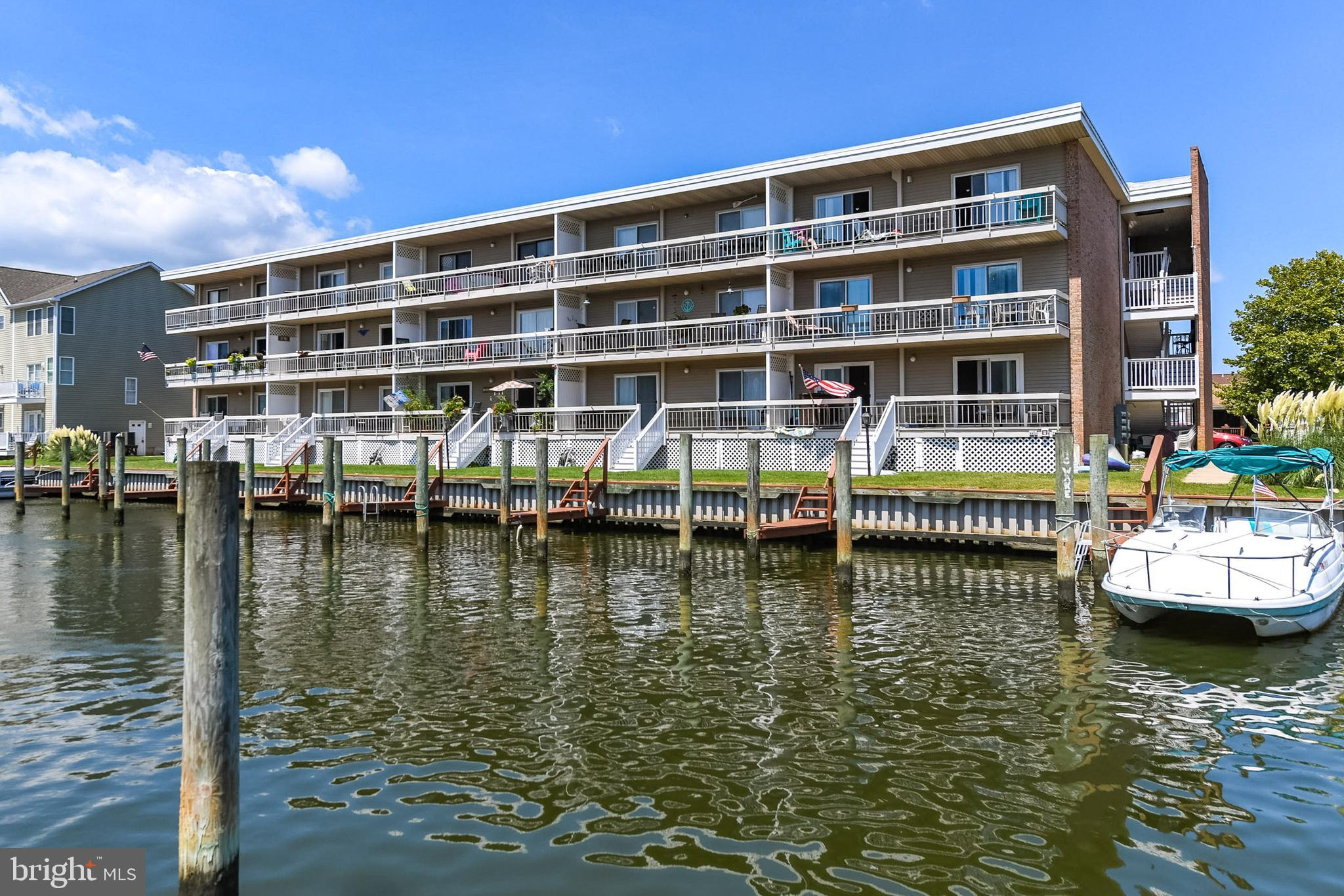 Amazing opportunity to own a direct waterfront 1st floor, end unit condo with a boat slip and parkin