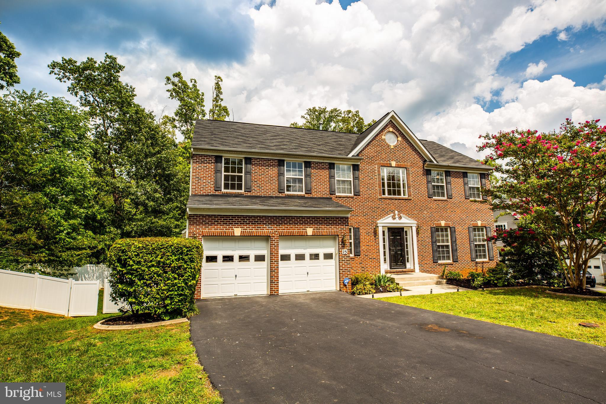 WOW!  PRISTINE one owner sun filled brick front home READY TO MOVE IN.  Three finished levels locate